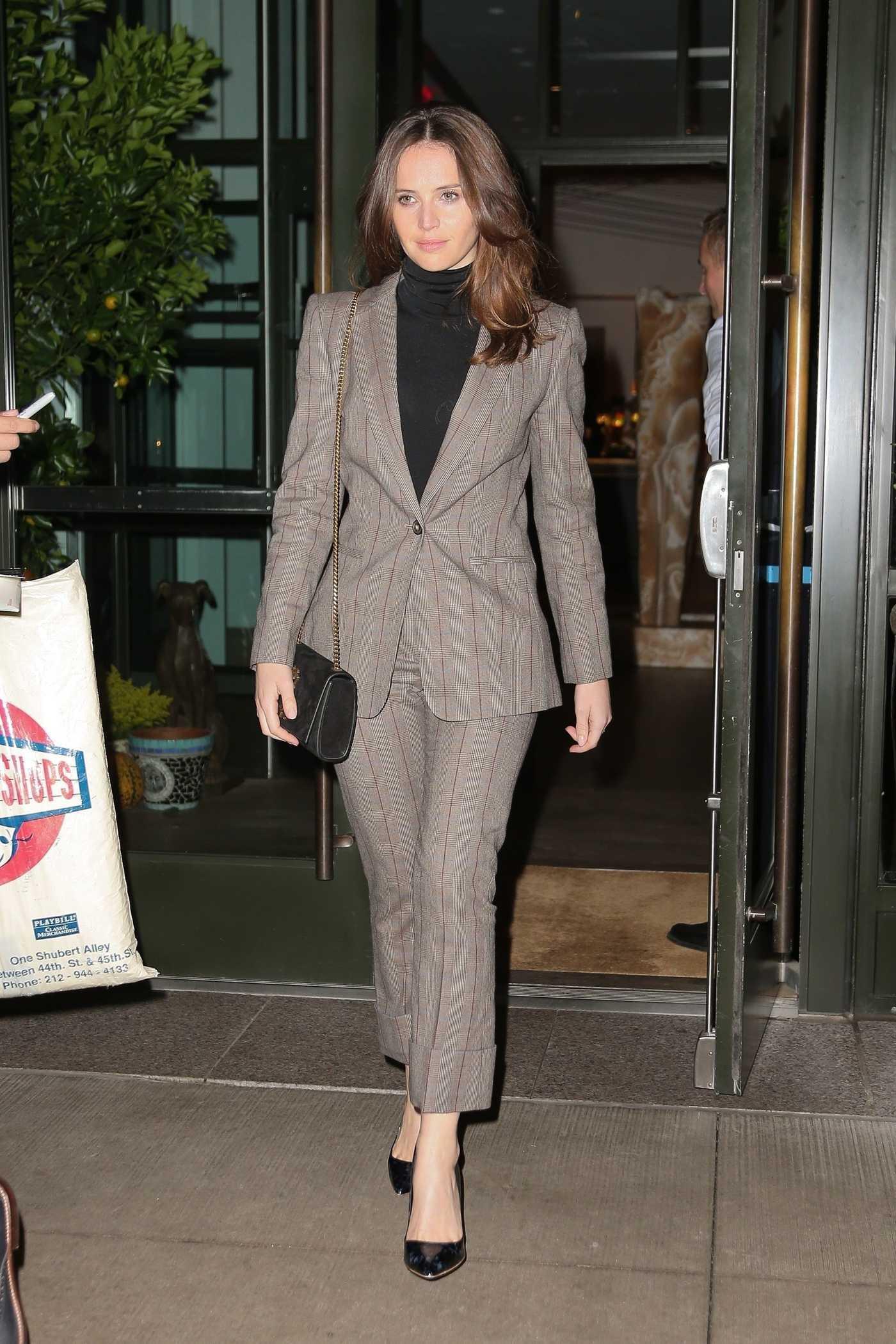 Felicity Jones in a Black Turtleneck Leaves Her Hotel in NYC 11/07/2018