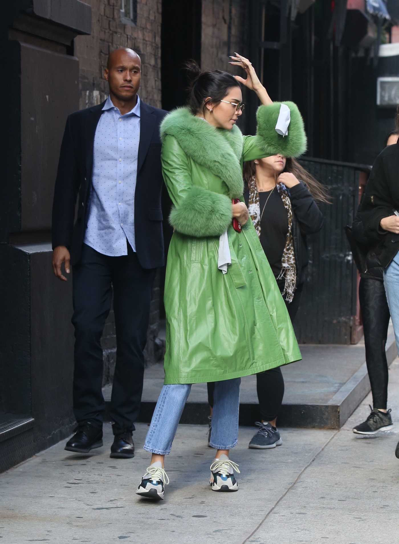 Kendall Jenner in a Green Leather Coat Riding a Citi Bike in NYC 11/03/2018
