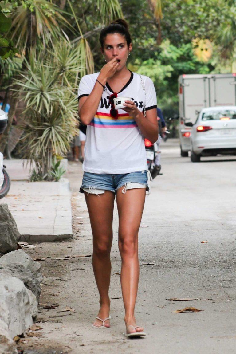 Sara Sampaio in a Blue Denim Ripped Shorts