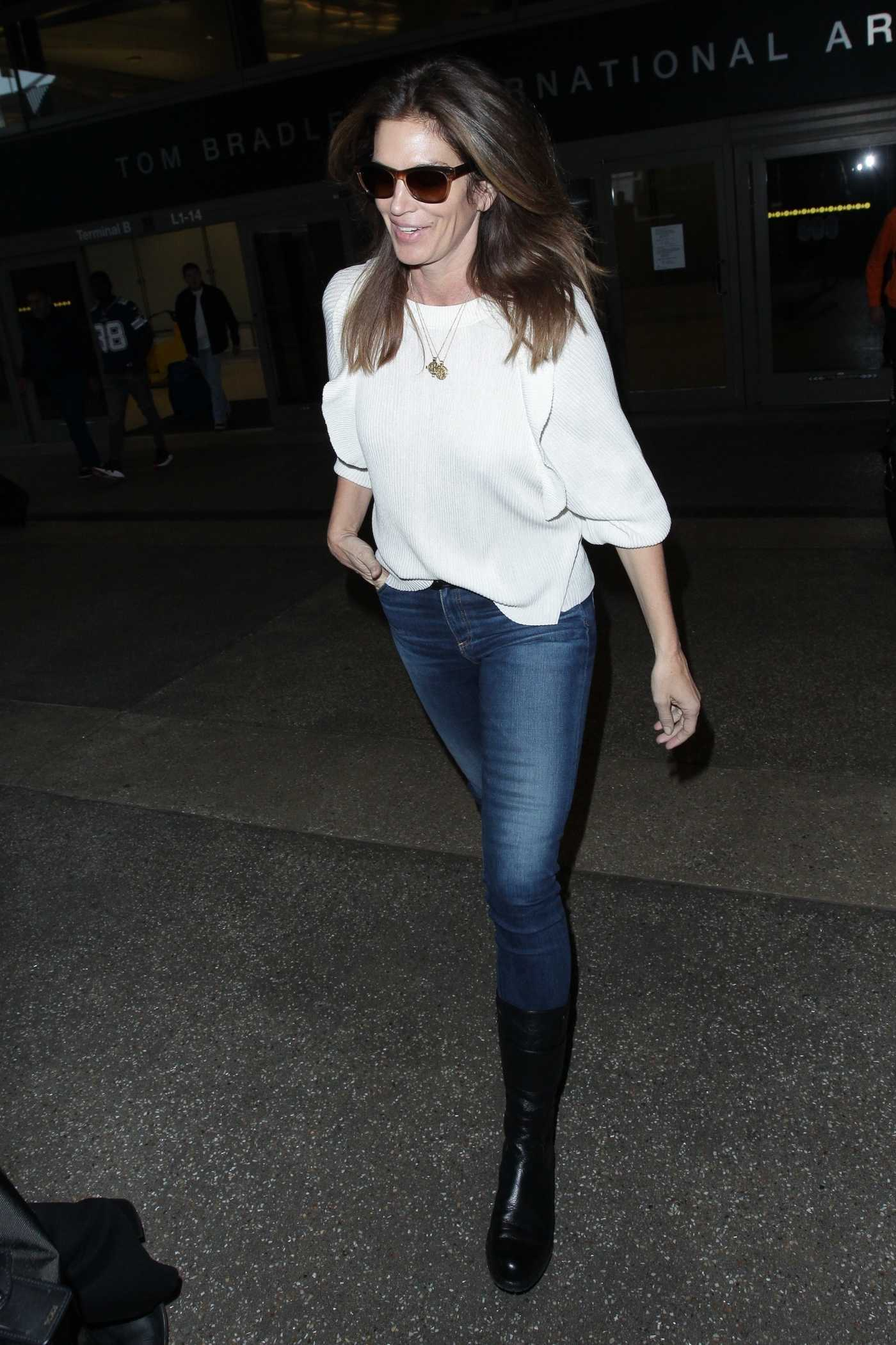 Cindy Crawford in a White Blouse Arrives at LAX Airport in Los Angeles 12/11/2018