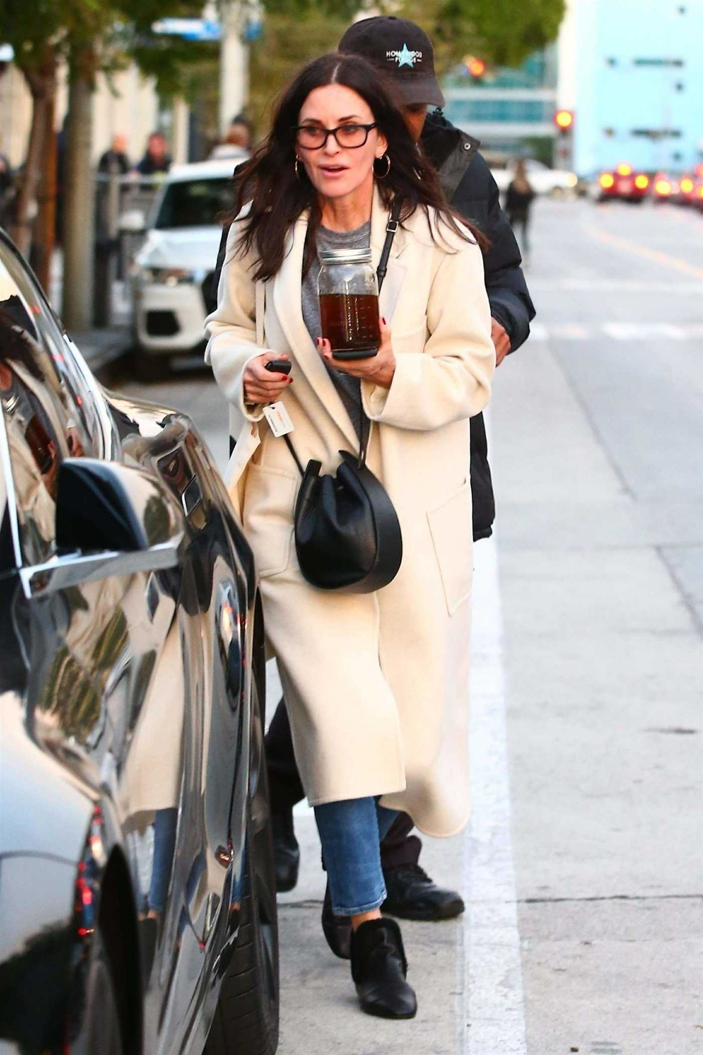 Courteney Cox in a White Coat Out for a Shopping Trip with a Friend in West Hollywood 12/26/2018