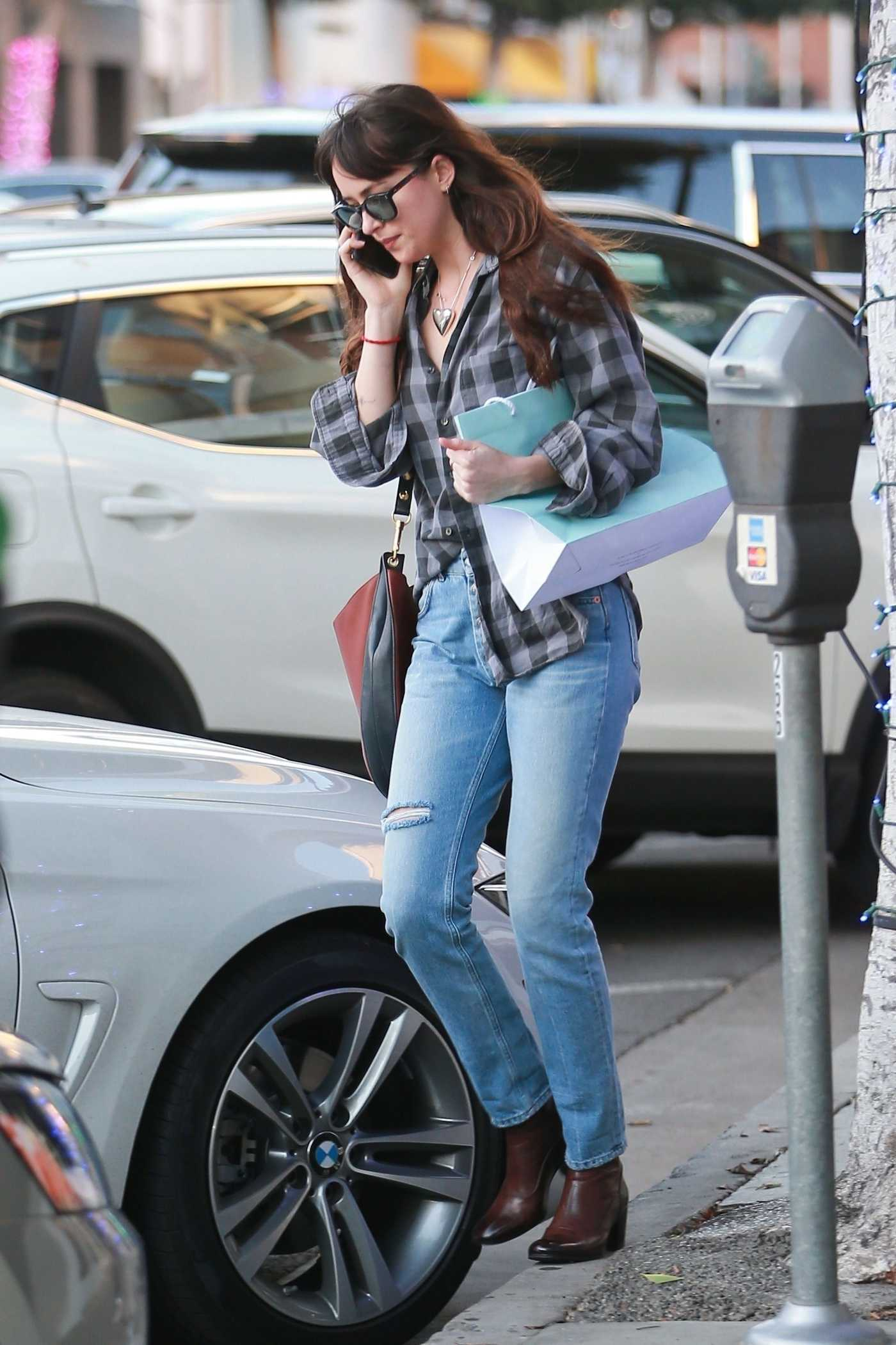 Dakota Johnson in a Plaid Shirt Does Some Christmas Shopping in Beverly Hills 12/20/2018