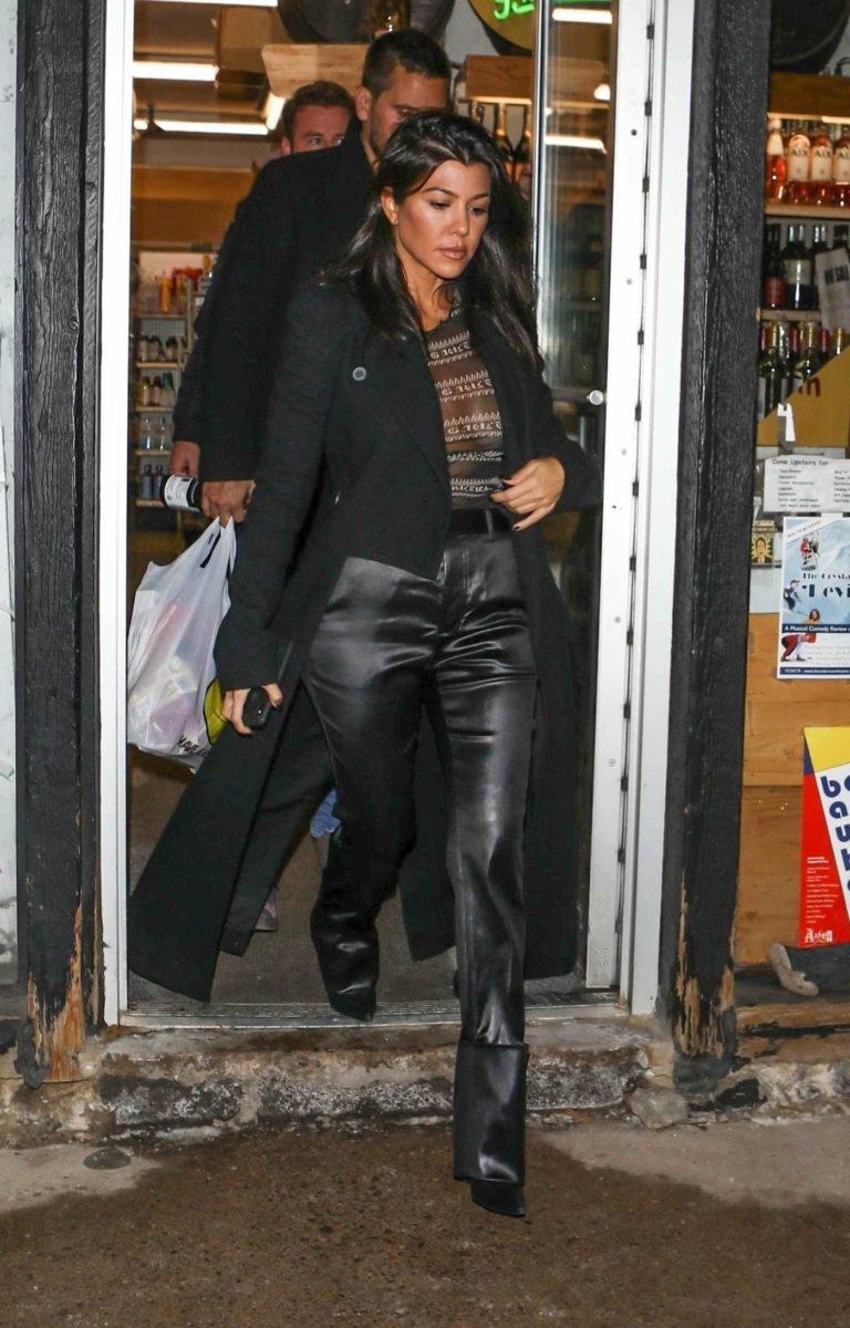 Kourtney Kardashian in a Black Coat
