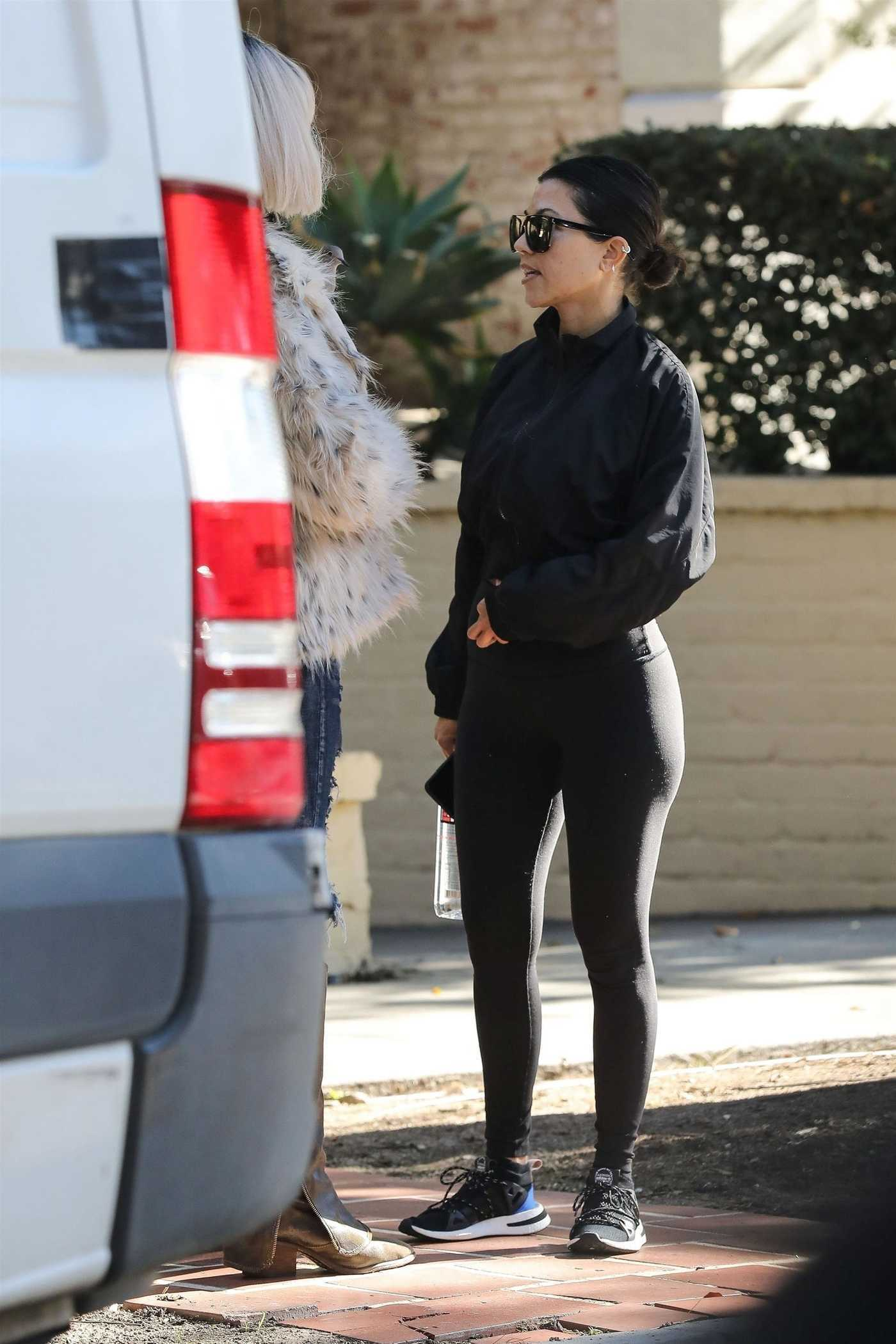 Kourtney Kardashian in a Black Leggings Arrives at a Friend's House in West Hollywood 12/27/2018
