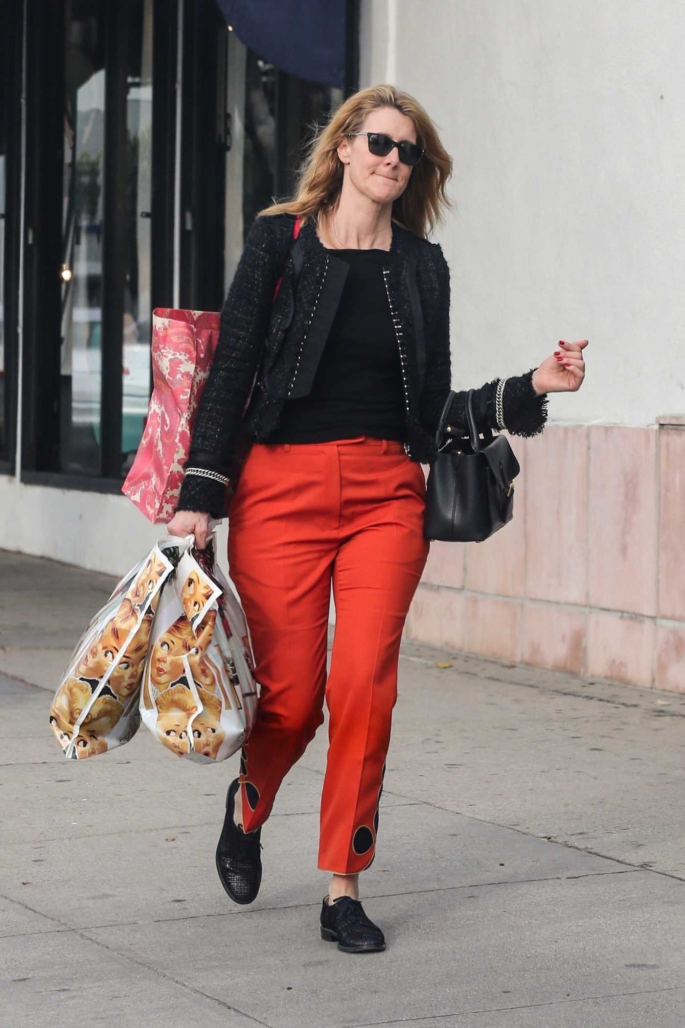 Laura Dern in a Red Pants Goes Shopping at American Rag in Los Angeles 12/22/2018