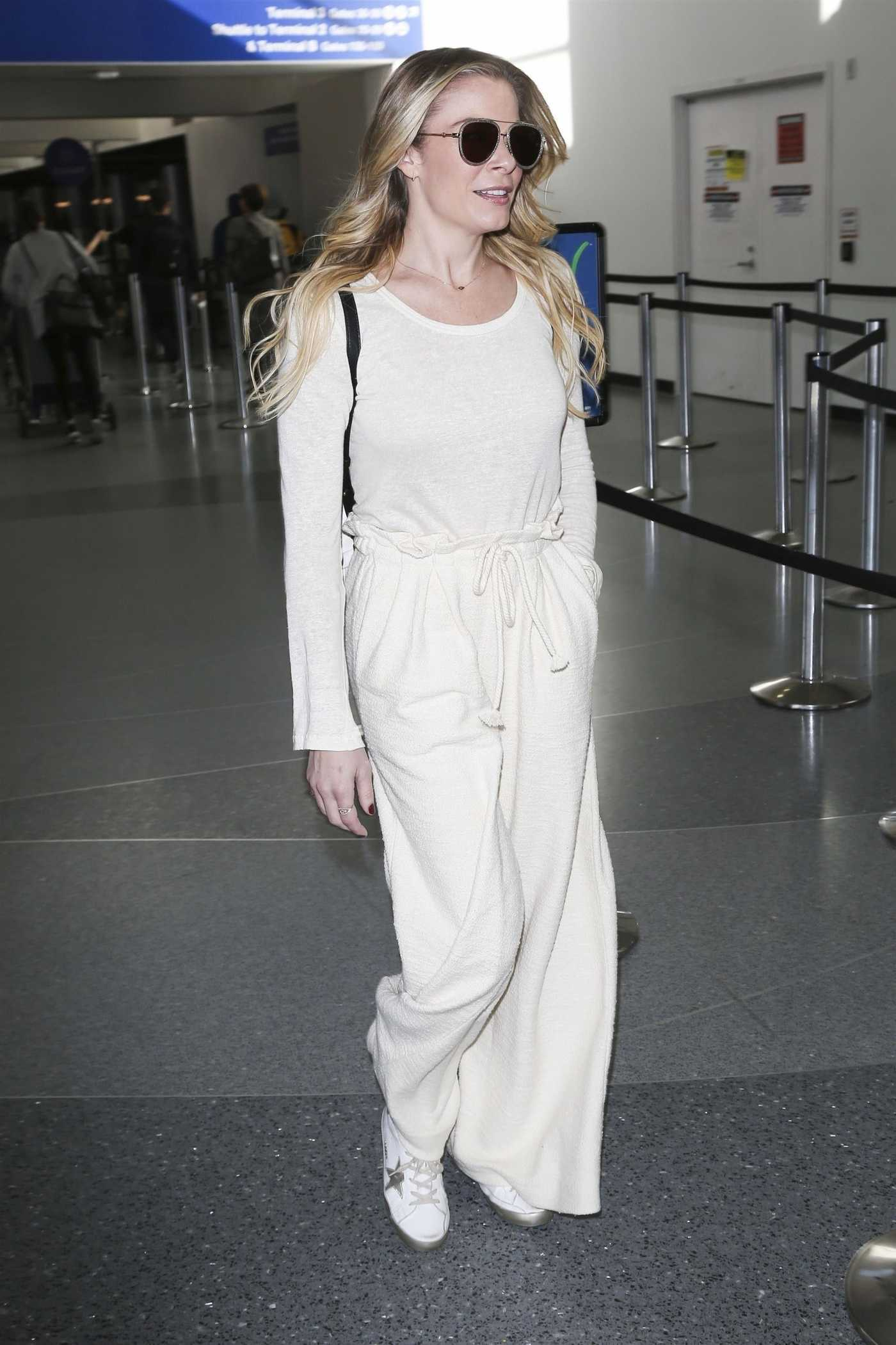 LeAnn Rimes in a White Sweatpants Arrives at LAX Airport in LA 12/26/2018