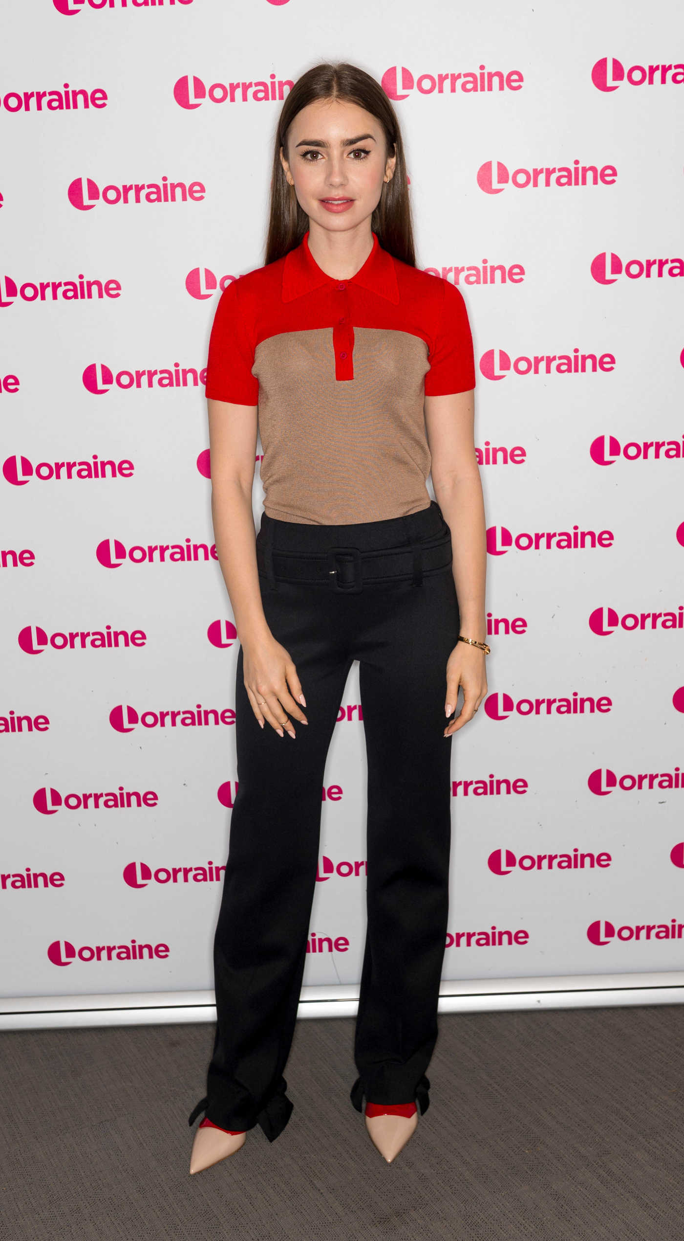 Lily Collins Attends Lorraine TV Show in London 12/20/2018