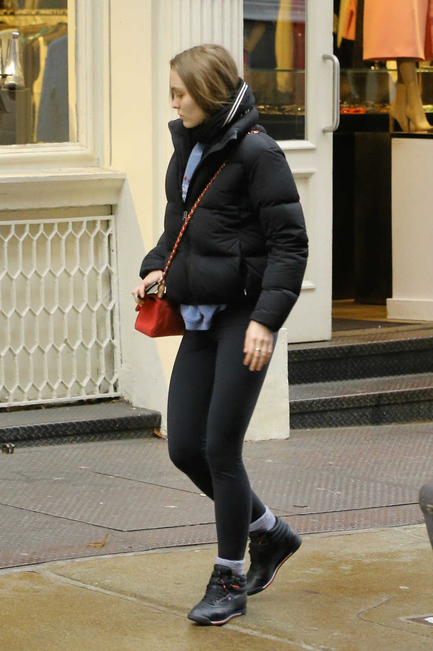 Lily-Rose Depp in a Black Puffer Jacket Was Seen Out in New York 12/13/2018