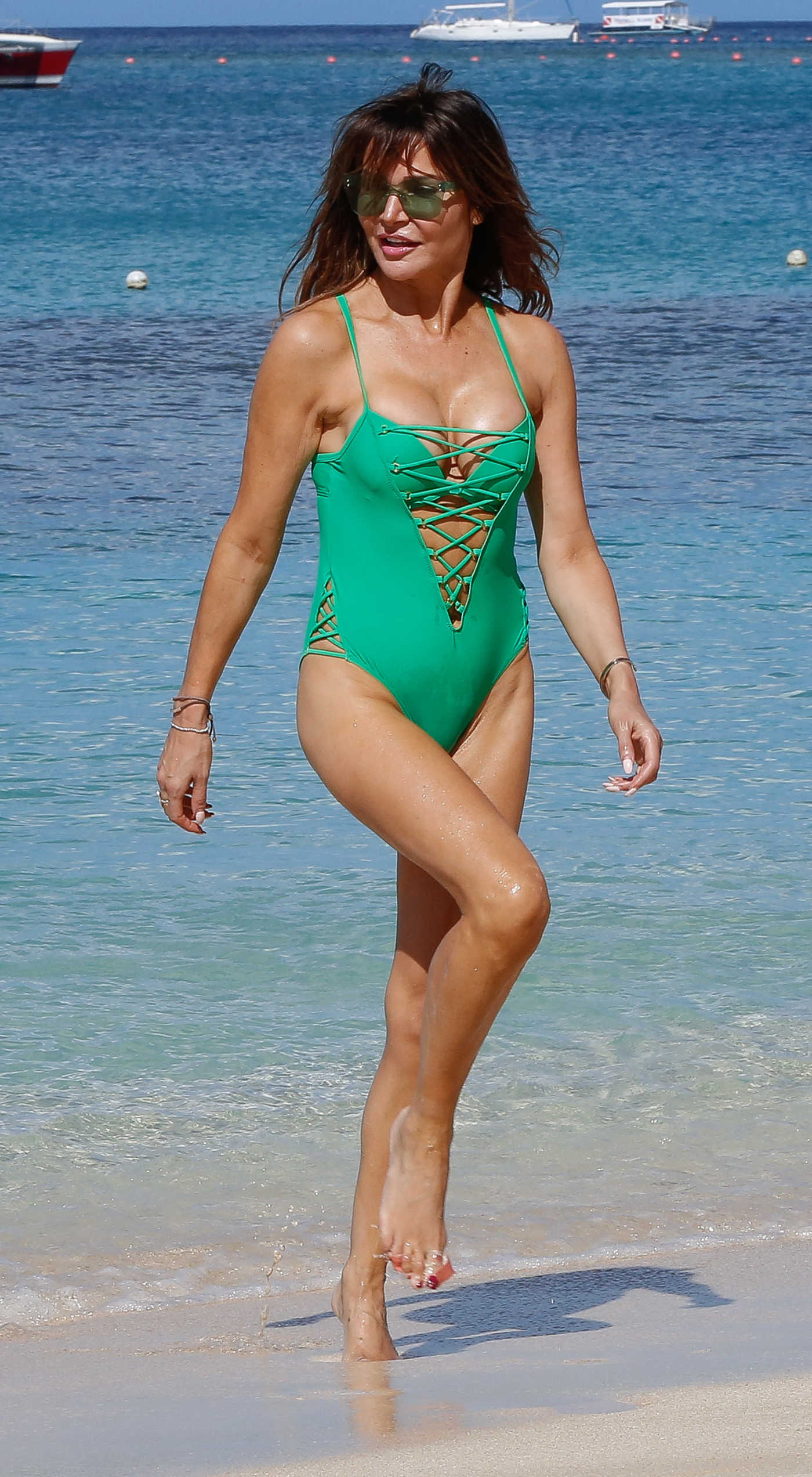 Lizzie Cundy in a Green Swimsuit on the Beach in Barbados 12/29/2018
