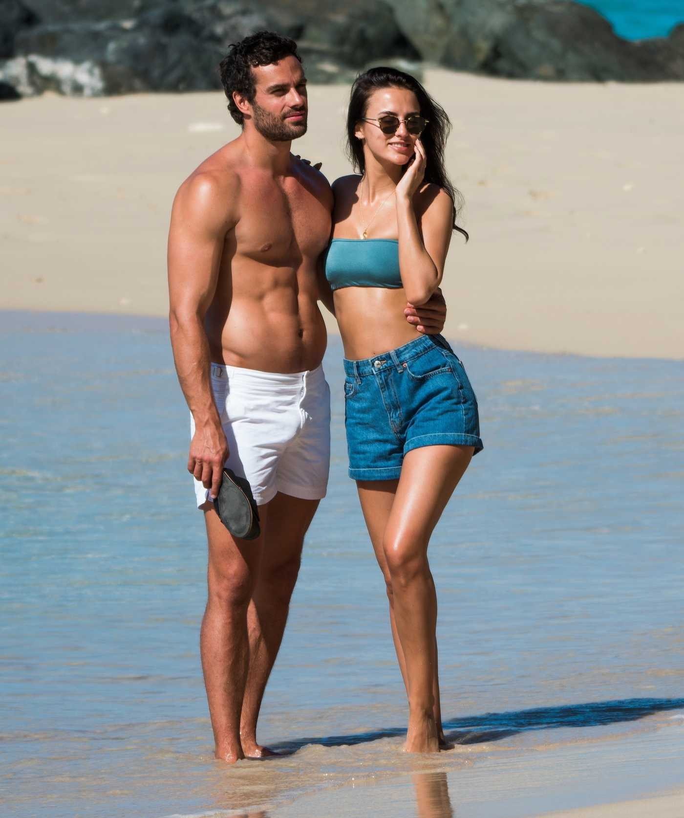 Lucy Watson in a Blue Bikini Top Out with James Dunmore on the Beach in Barbados 12/25/2018