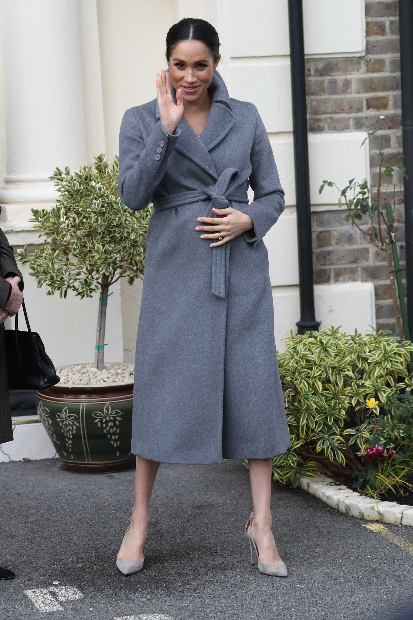 Meghan Markle in a Gray Coat Visits Brinsworth House in Isleworth 12/17/2018