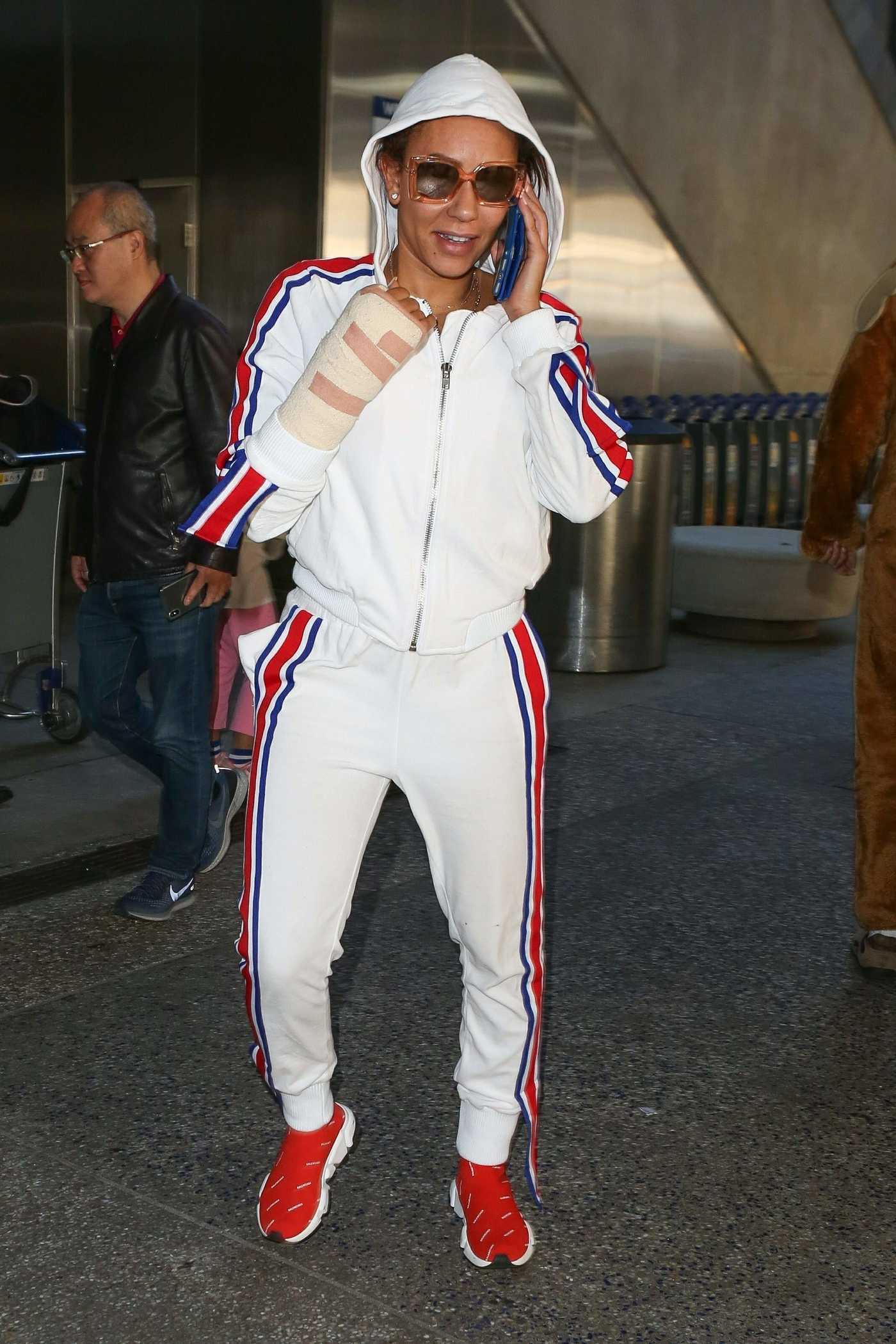 Melanie Brown in a White Jogging Suit Arrives at LAX Airport in Los Angeles 12/21/2018