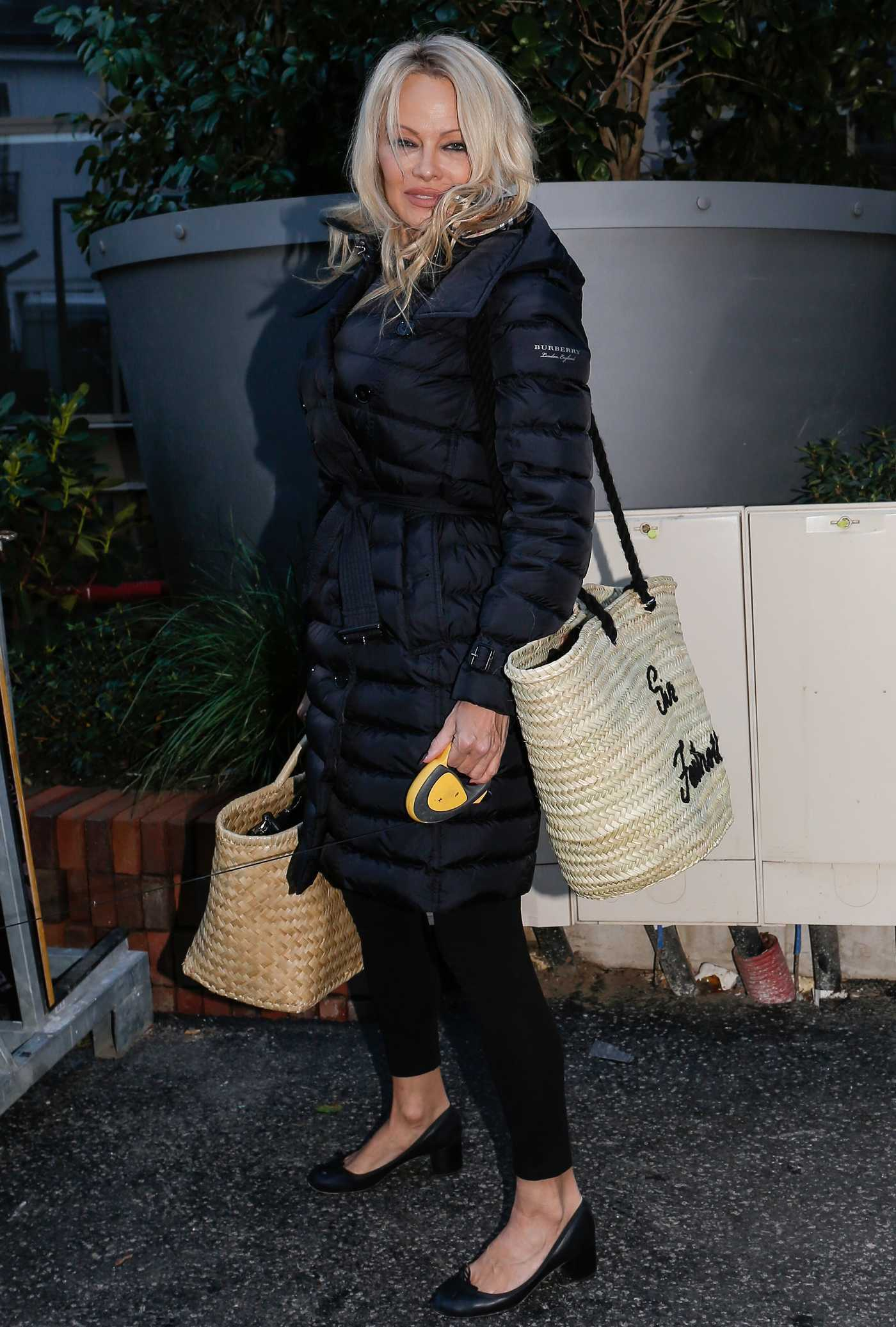 Pamela Anderson in a Black Down-Padded Coat Leaves Her Hotel in Paris 11/30/2018