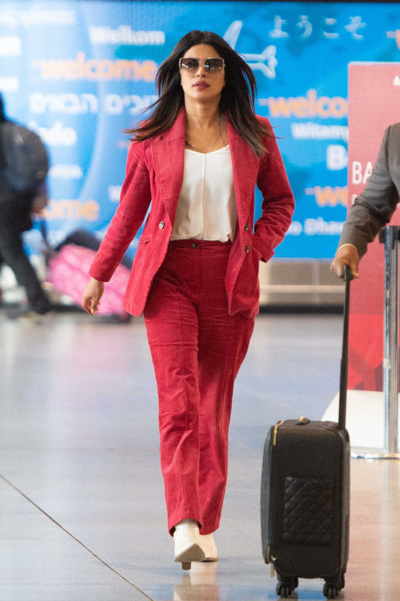 Priyanka Chopra in a Red Suit Arrives at JFK Airport in New York 12/15/2018