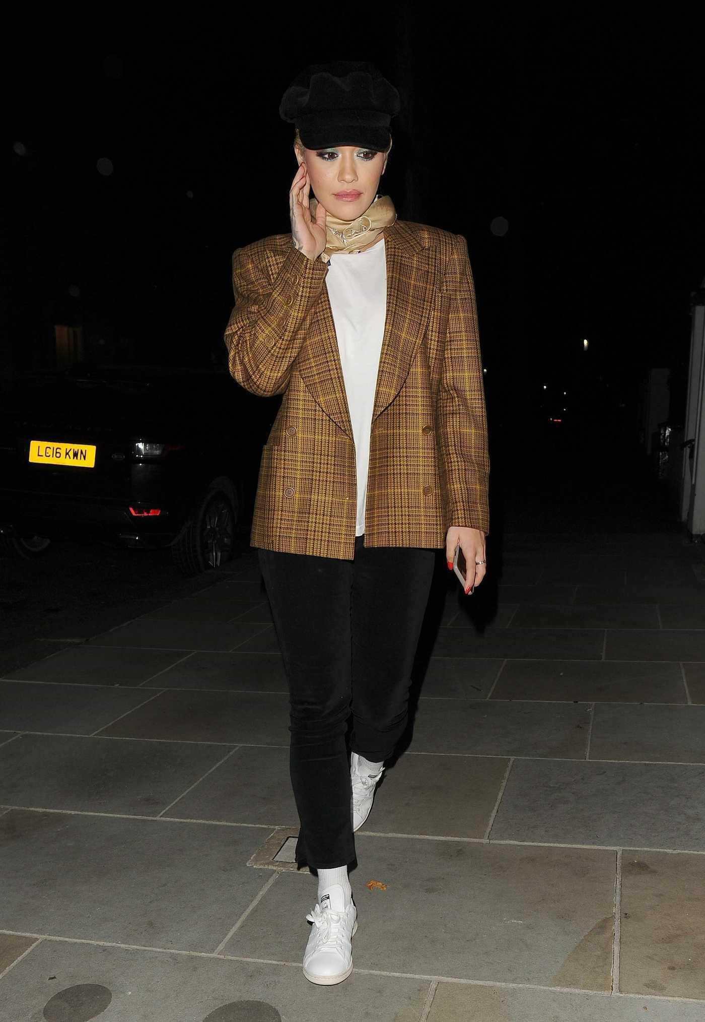 Rita Ora in a Black Cap Leaves the Television Centre in London 12/12/2018