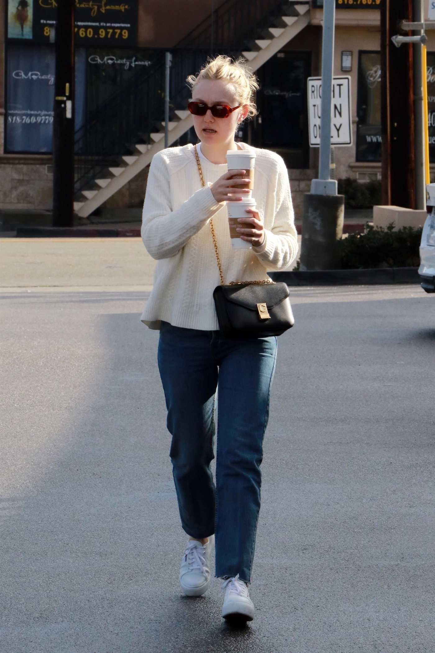 Dakota Fanning in a White Sweater Grabs Coffee in Studio City 01/06/2019