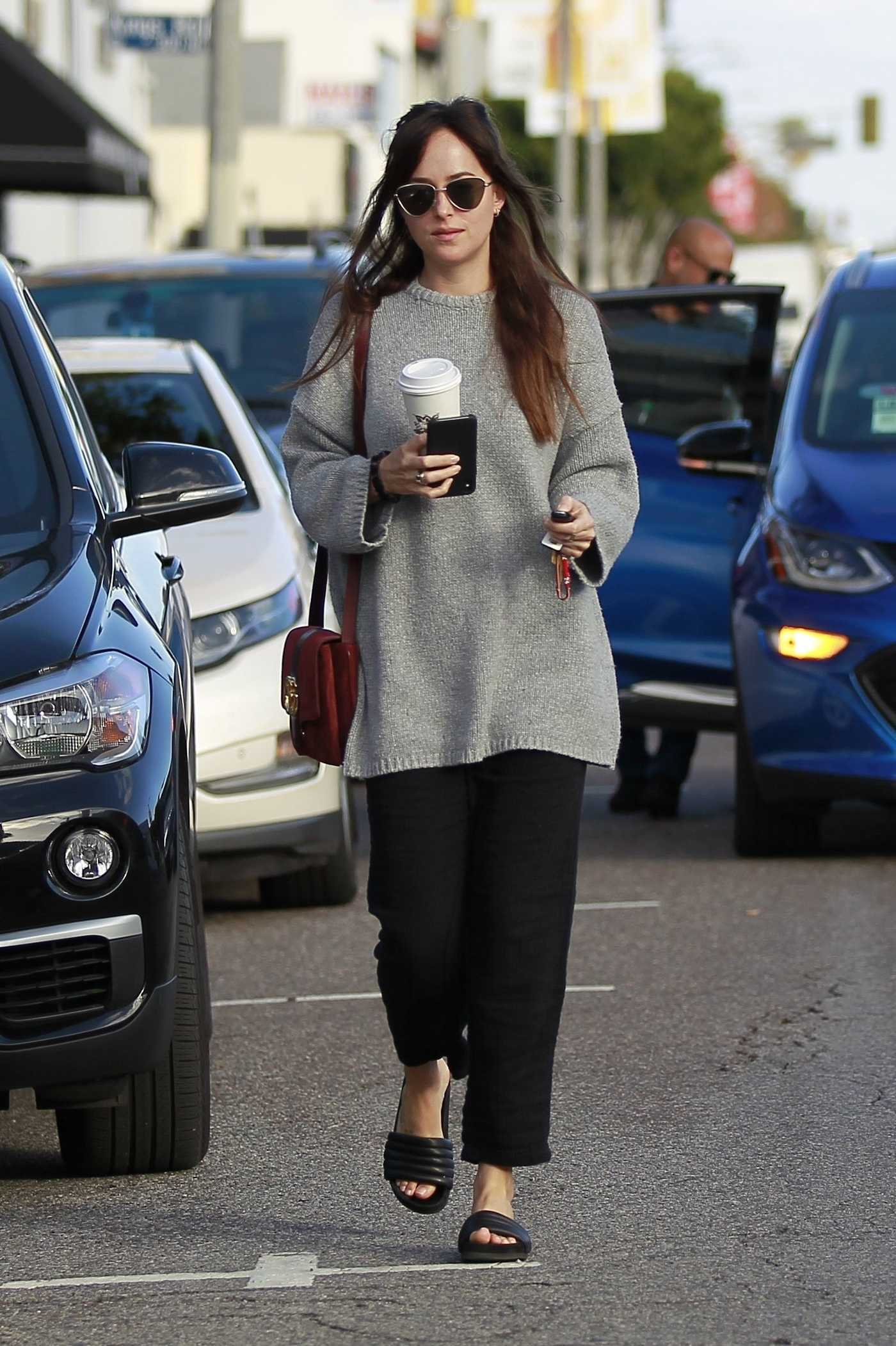 Dakota Johnson in a Gray Sweater Gets Some Grocery Shopping Done at Erewhon Market in West Hollywood 01/06/2019