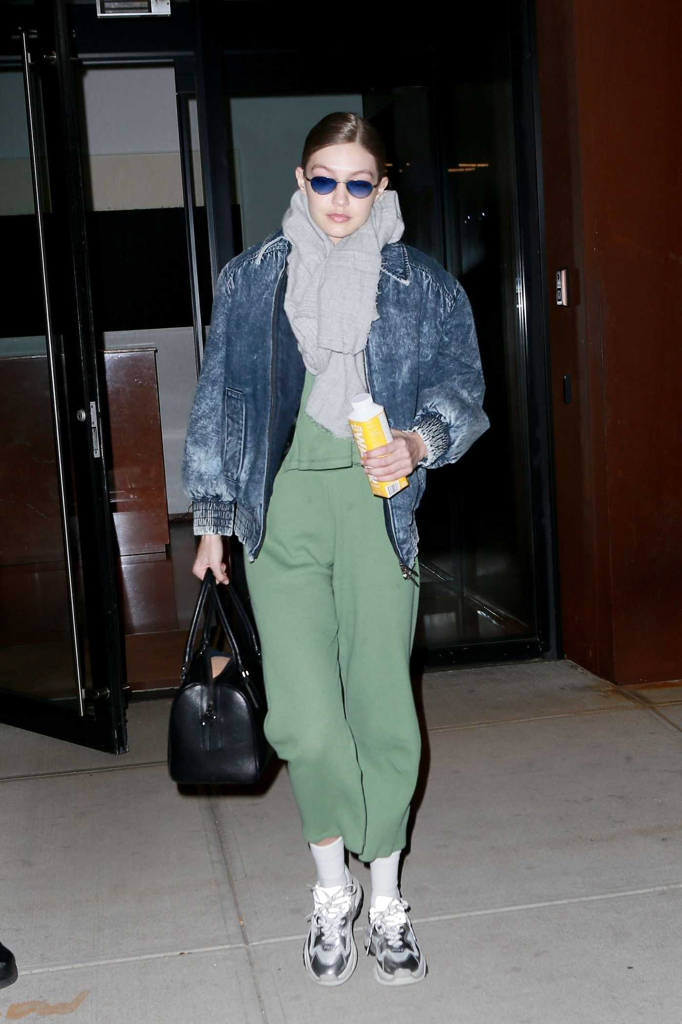 Gigi Hadid in a Green Sweatpants Leaves Her Apartment in NYC 01/11/2019