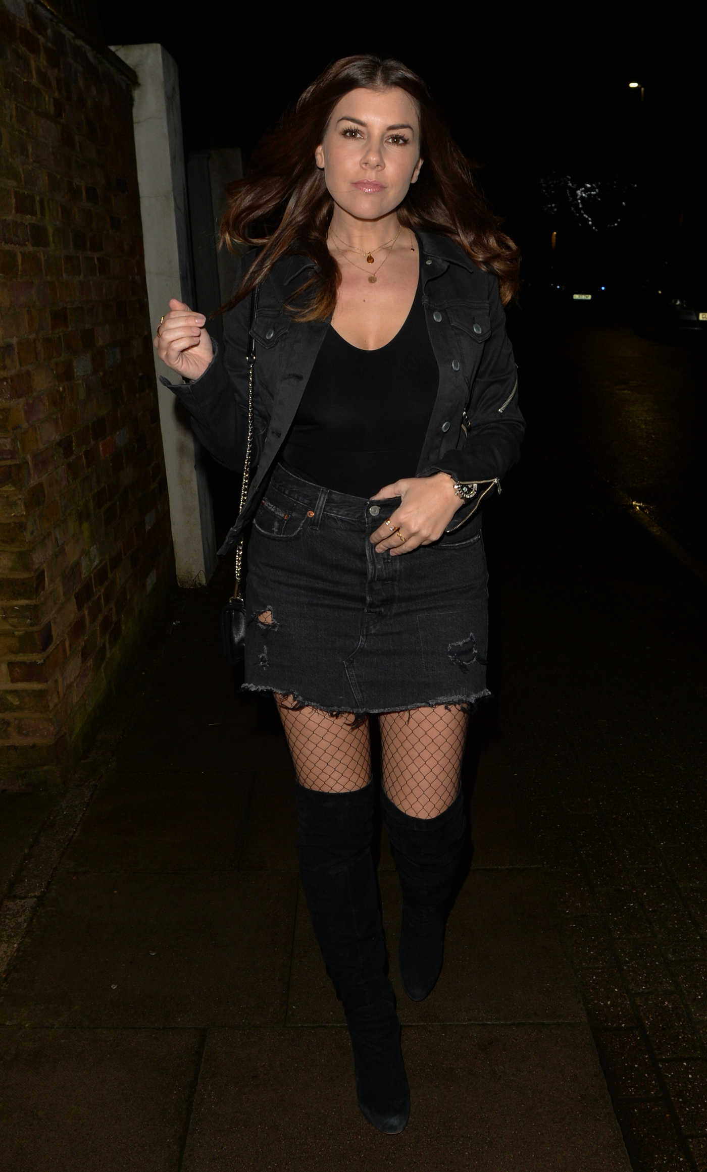 Imogen Thomas in a Black Ripped Denim Skirt Arrives at Soho House in London 01/26/2019