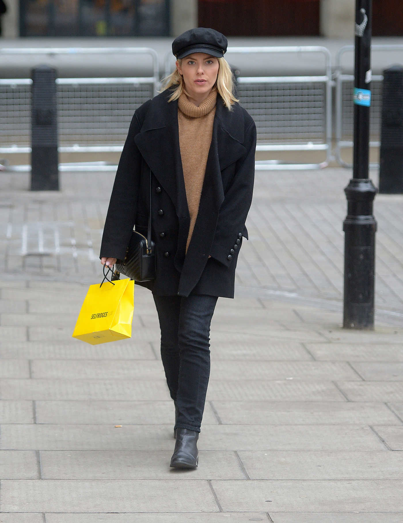 Mollie King in a Black Cap Arrives at the BBC Radio 1 Studios in London 01/12/2019