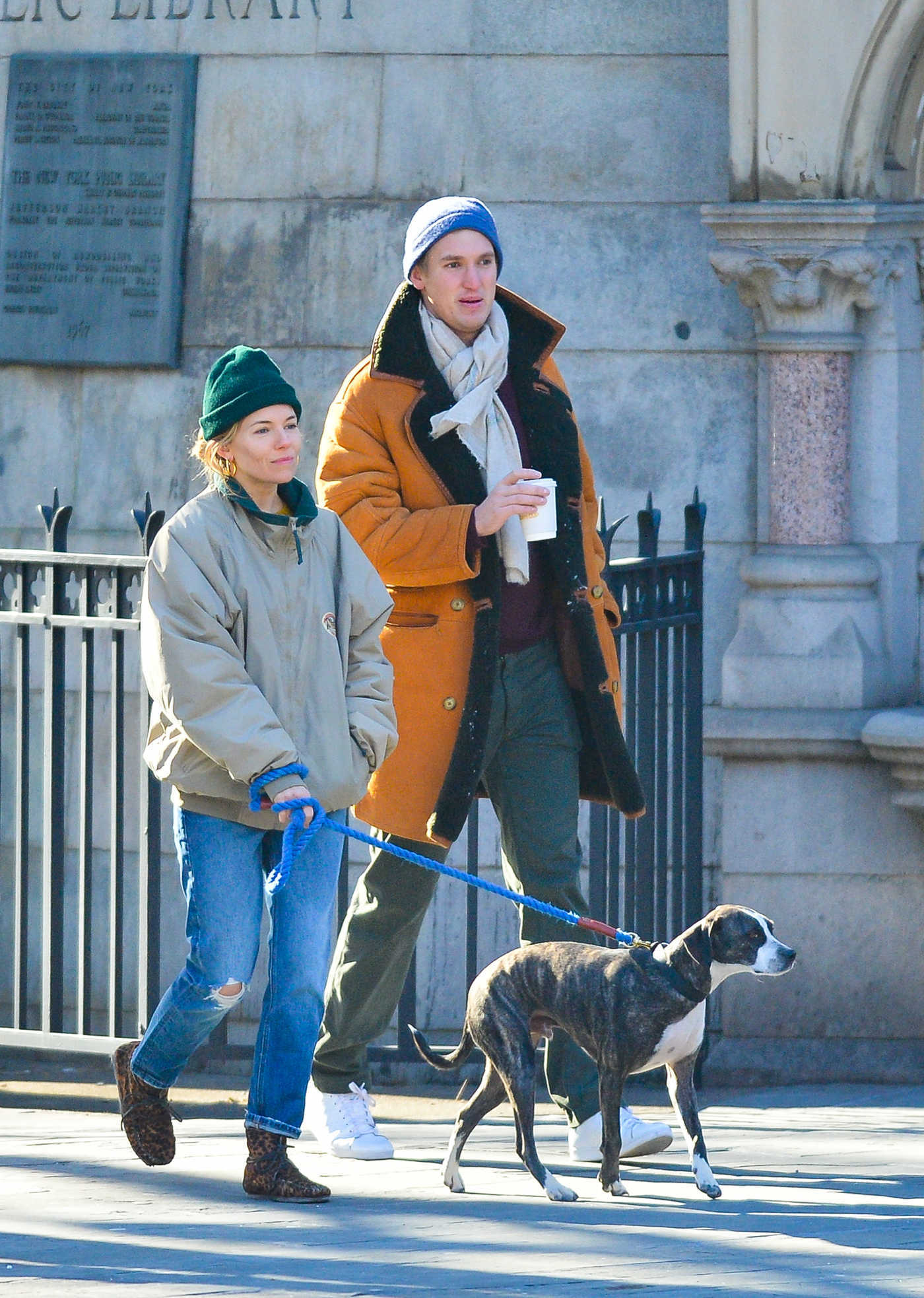 Sienna Miller in a Green Knit Hat Walks Her Dog Out in New York 01/13/2019