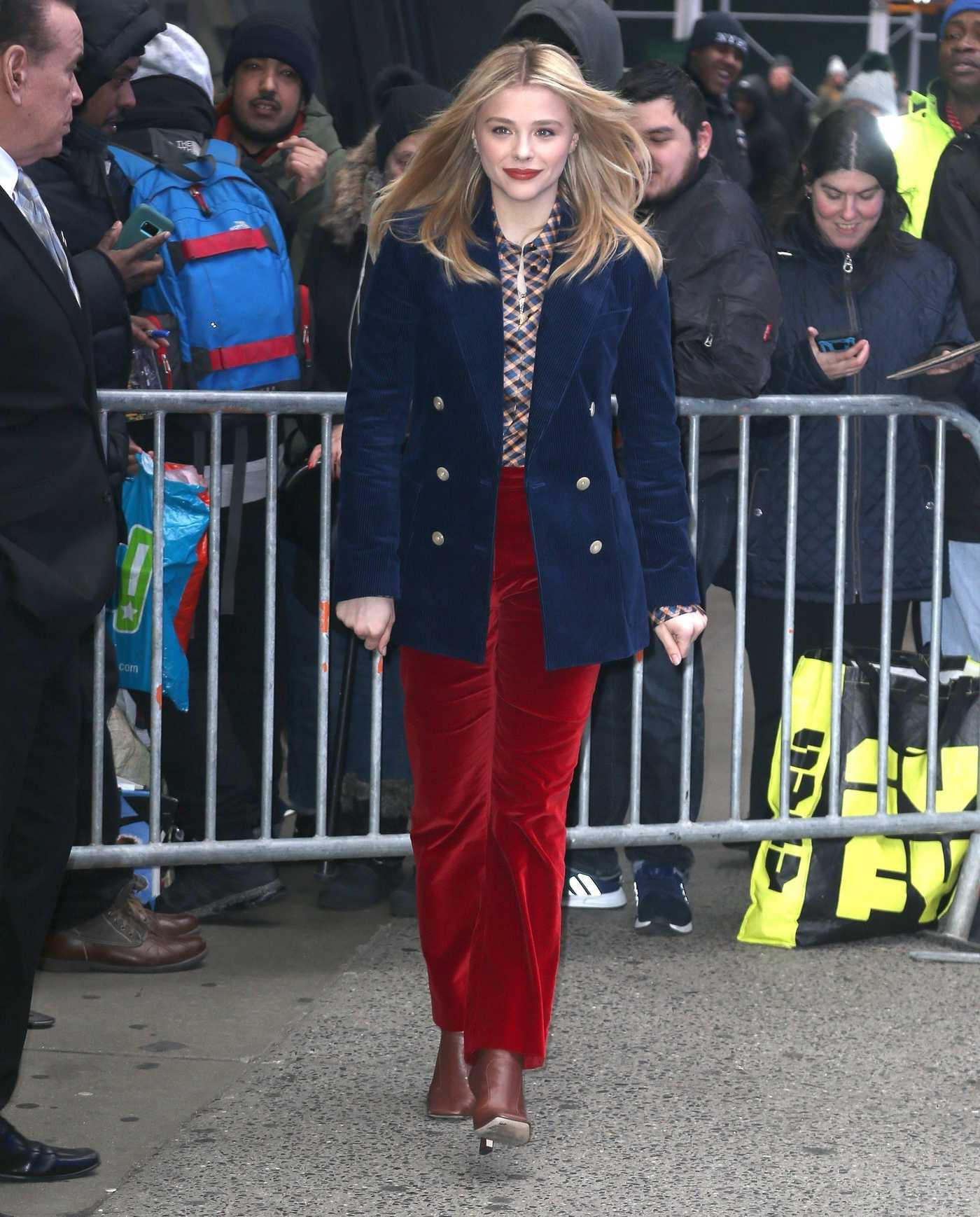 Chloe Moretz in a Red Pants Arrives at Good Morning America in NYC 02/20/2019