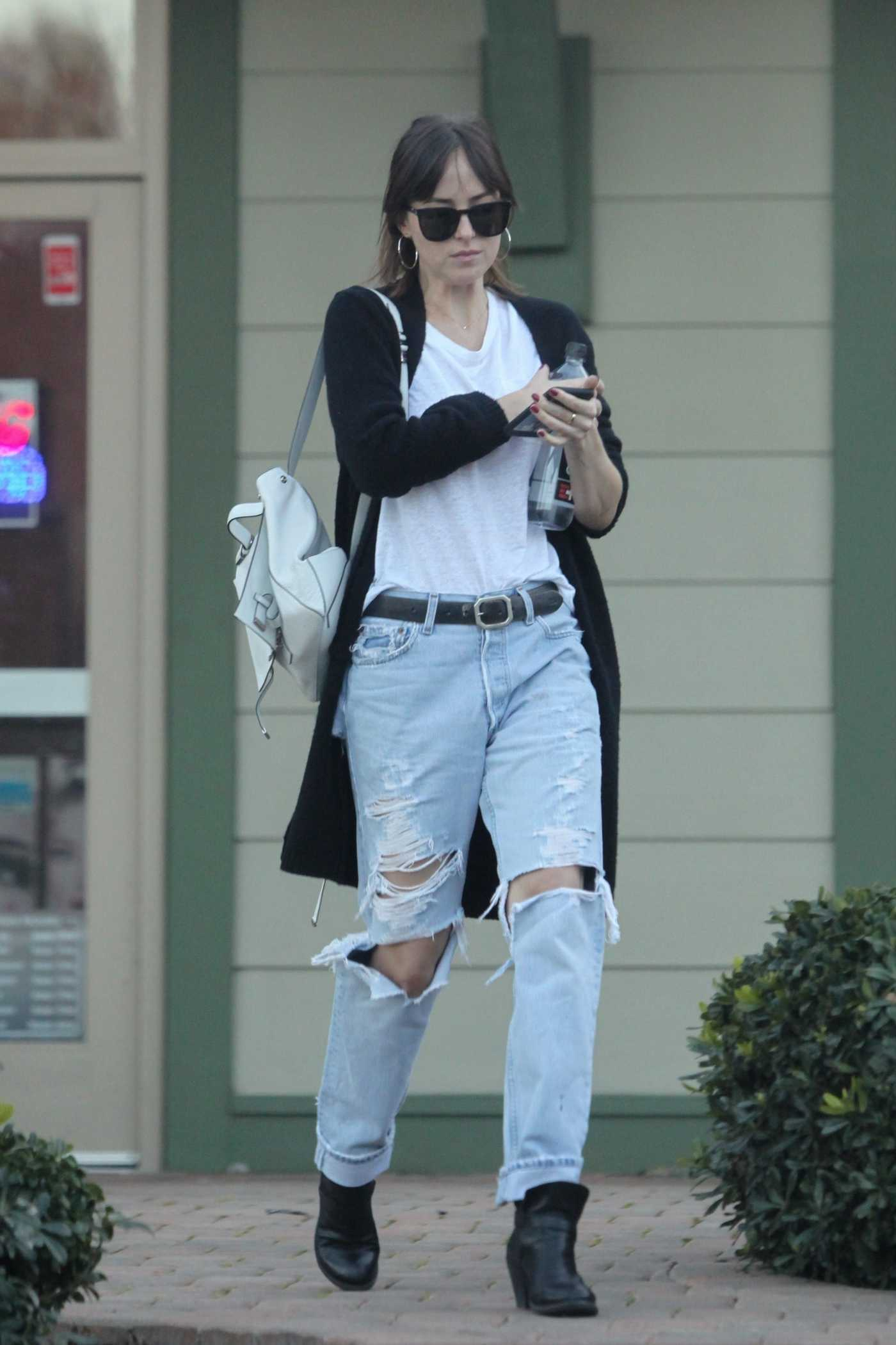 Dakota Johnson in a Blue Ripped Jeans Arrives at a Nail Salon in LA 02/11/2019