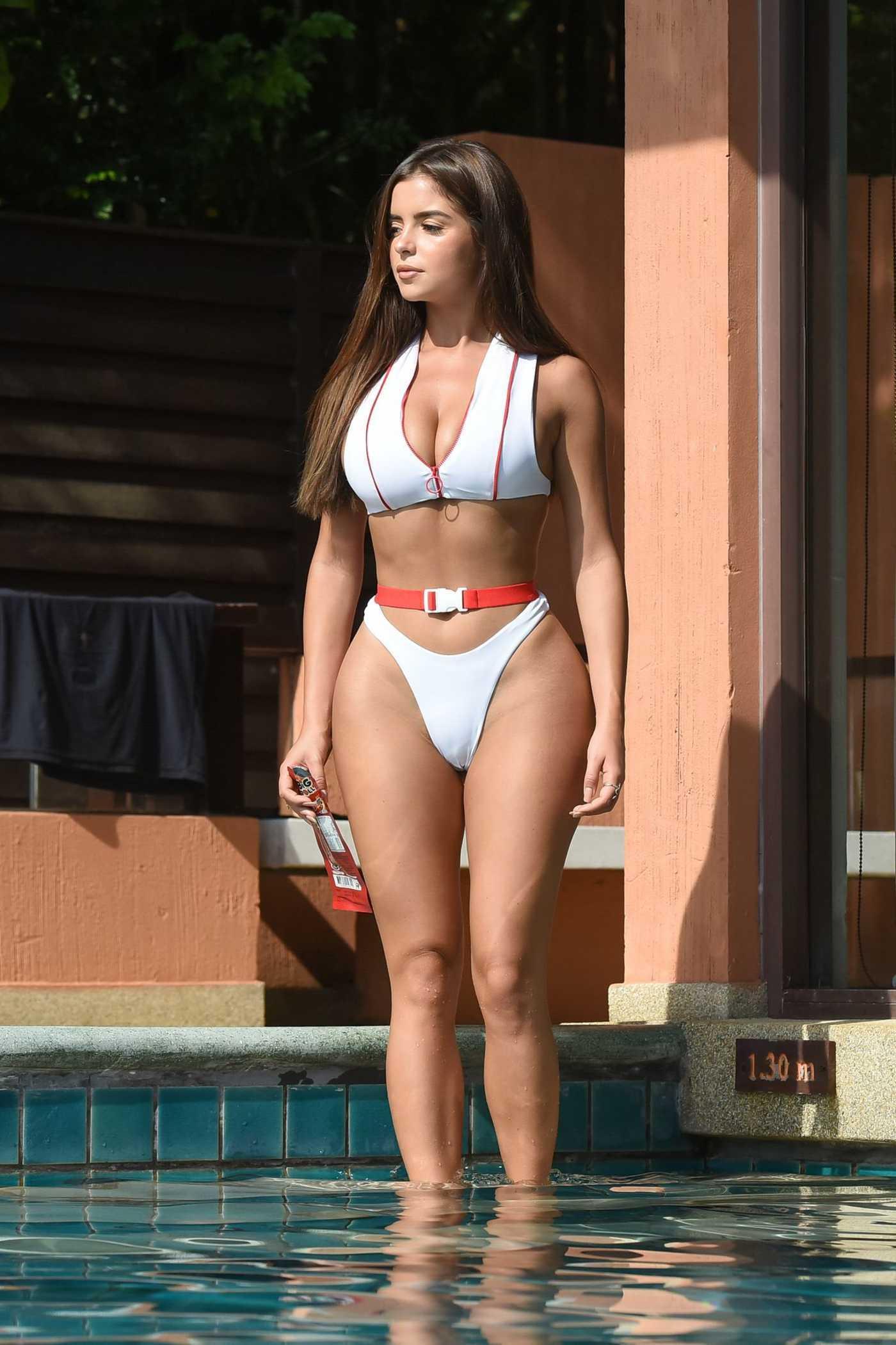 Demi Rose in a White Bikini by the Pool in Phuket 01/24/2019