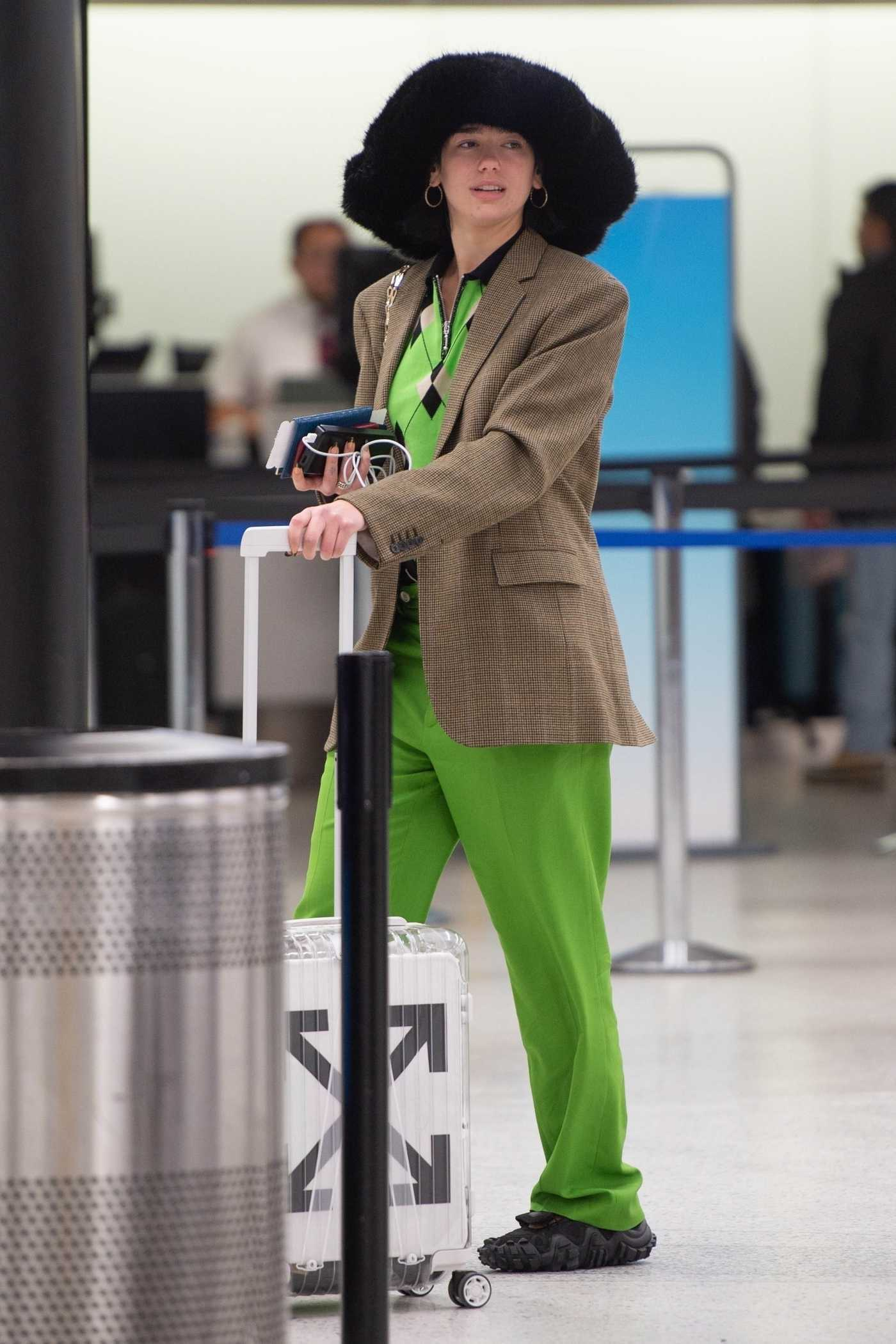 Dua Lipa in a Green Pants Arrives at JFK Airport in NYC 02/03/2019
