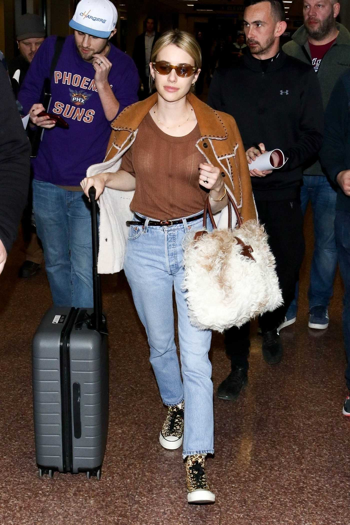Emma Roberts in a Beige T-Shirt Arrives at Airport in Salt Lake City 01/25/2019