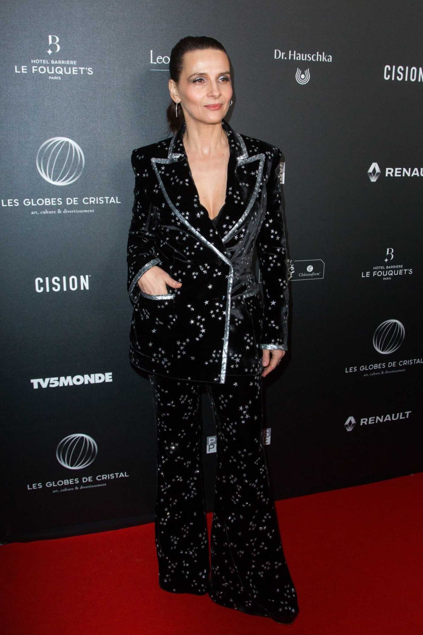 Juliette Binoche Attends the 14th Globe De Cristal Awards in Paris 02/04/2019