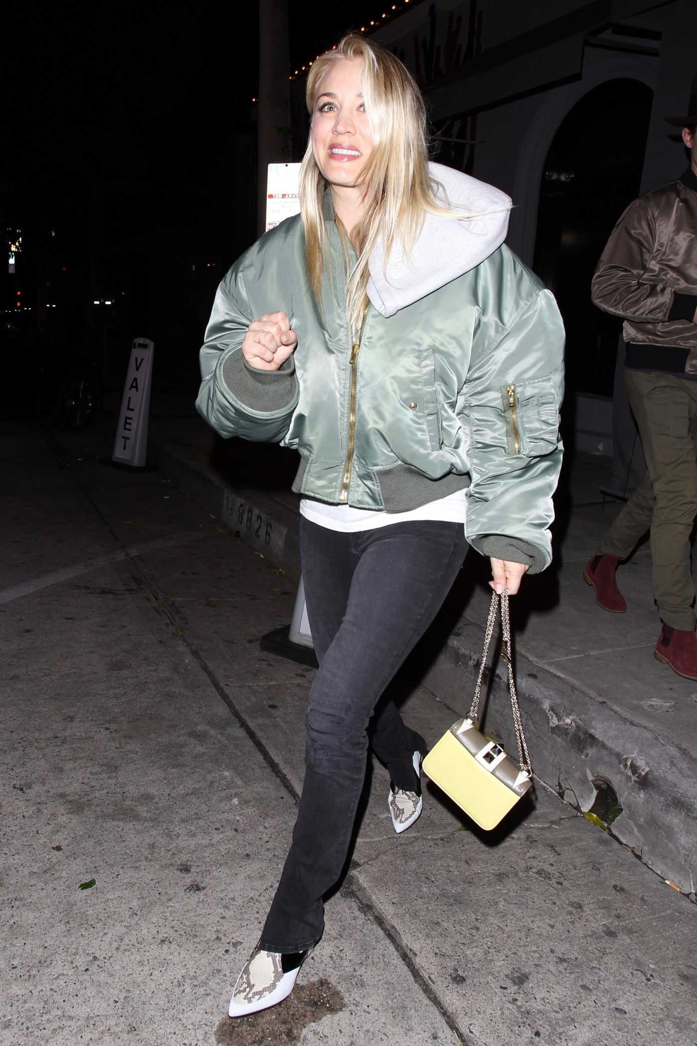 Kaley Cuoco in a Green Oversized Bomber Jacket Leaves Craig's Restaurant in West Hollywood 02/22/2019
