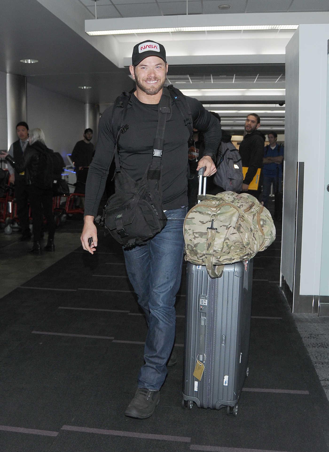 Kellan Lutz in a Black Cap Arrives at LAX Airport in LA 02/14/2019