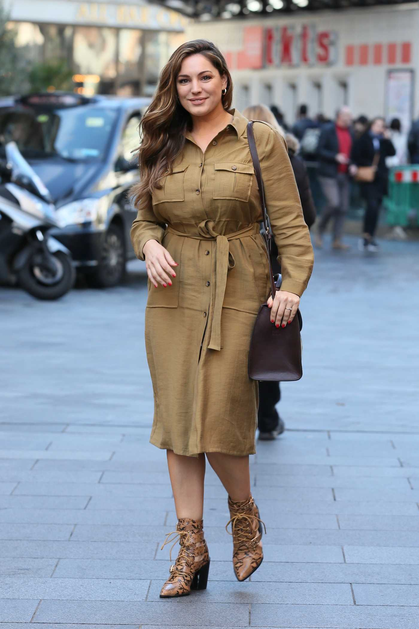 Kelly Brook in a Beige Dress Arrives at Global Radio Studios in London 02/19/2019
