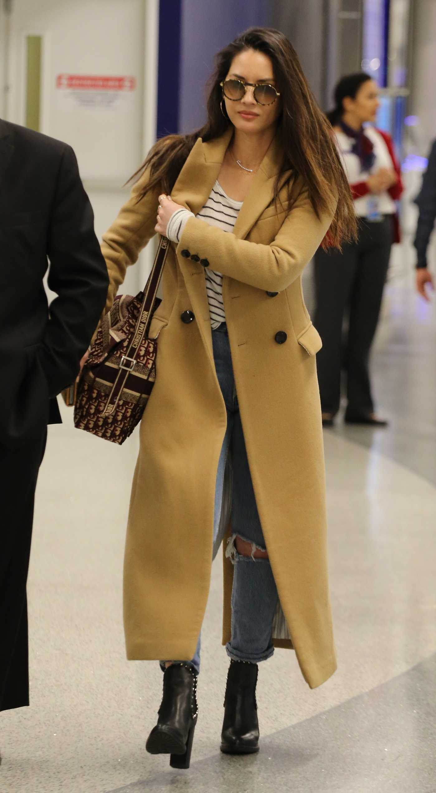 Olivia Munn in a Beige Coat Leaves LAX Airport in LA 02/26/2019