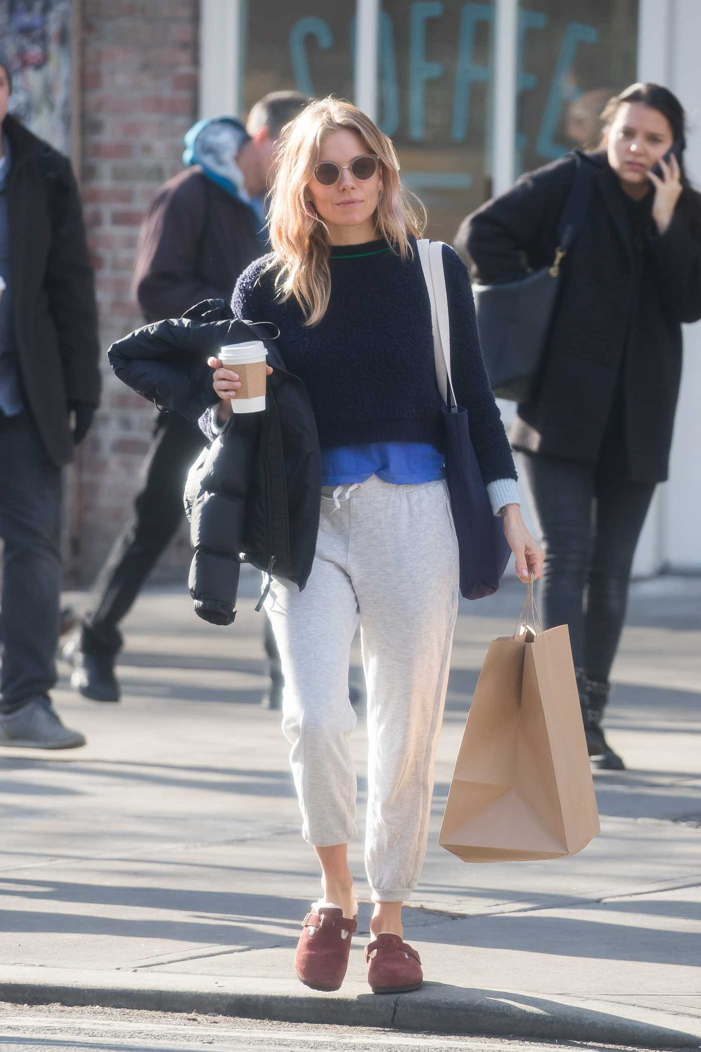 Sienna Miller in a Gray Sweatpants Goes Shopping in New York City 02/15/2019