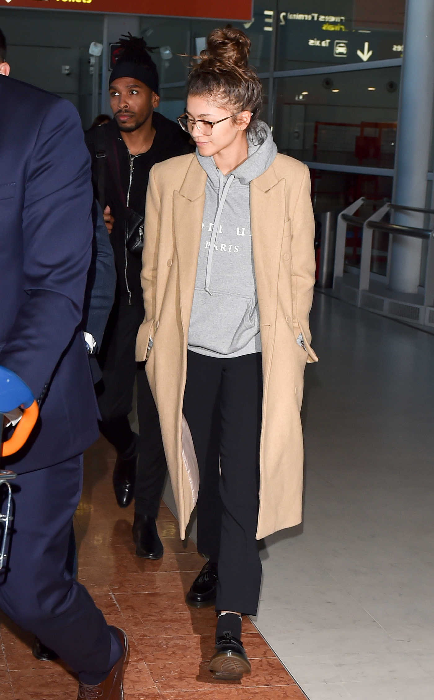 Zendaya in a Beige Coat Was Seen at Charles De Gaulle Airport in Paris 02/26/2019