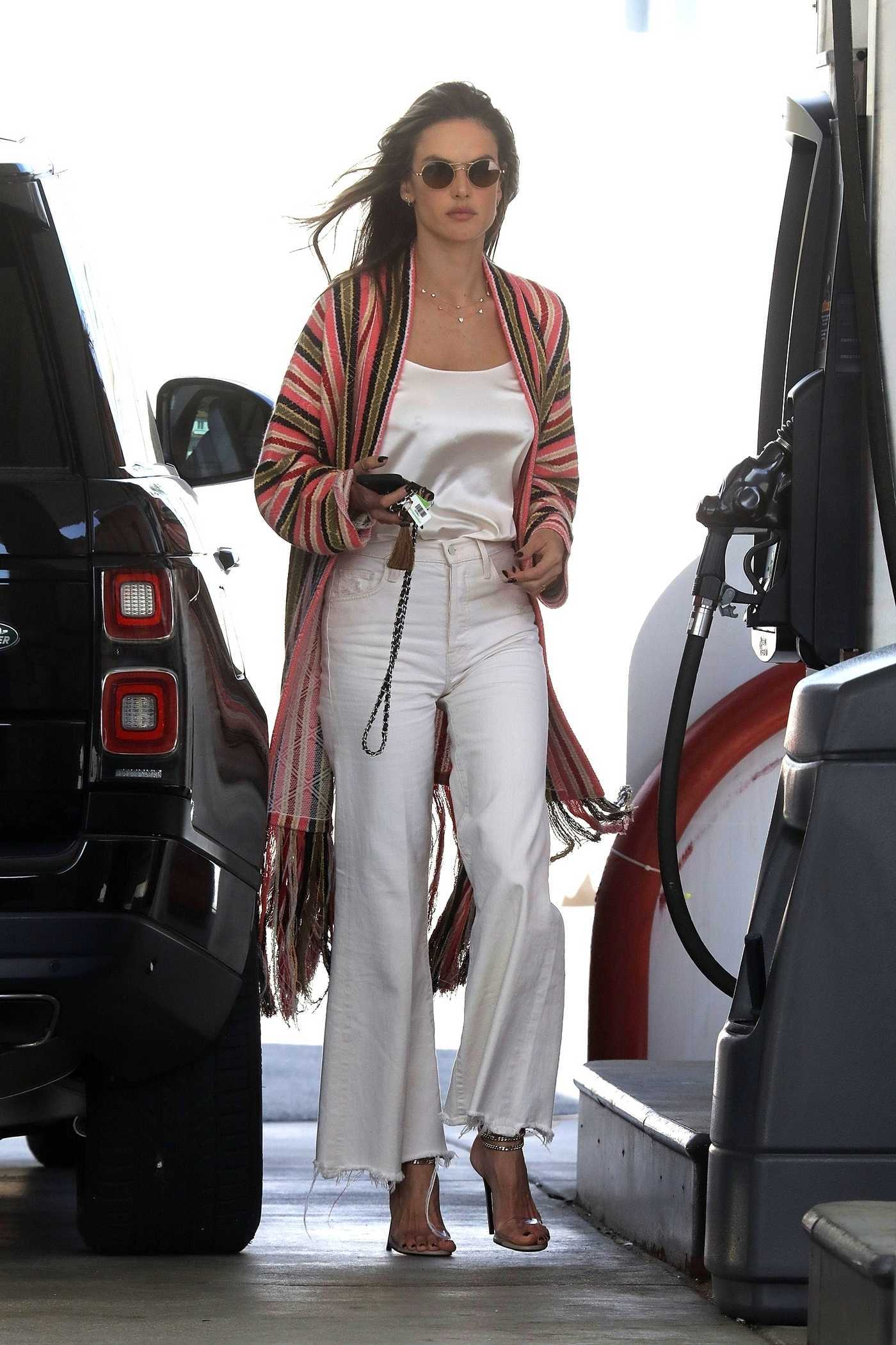 Alessandra Ambrosio in a White Pants Attends the Gas Station in Malibu 03/21/2019