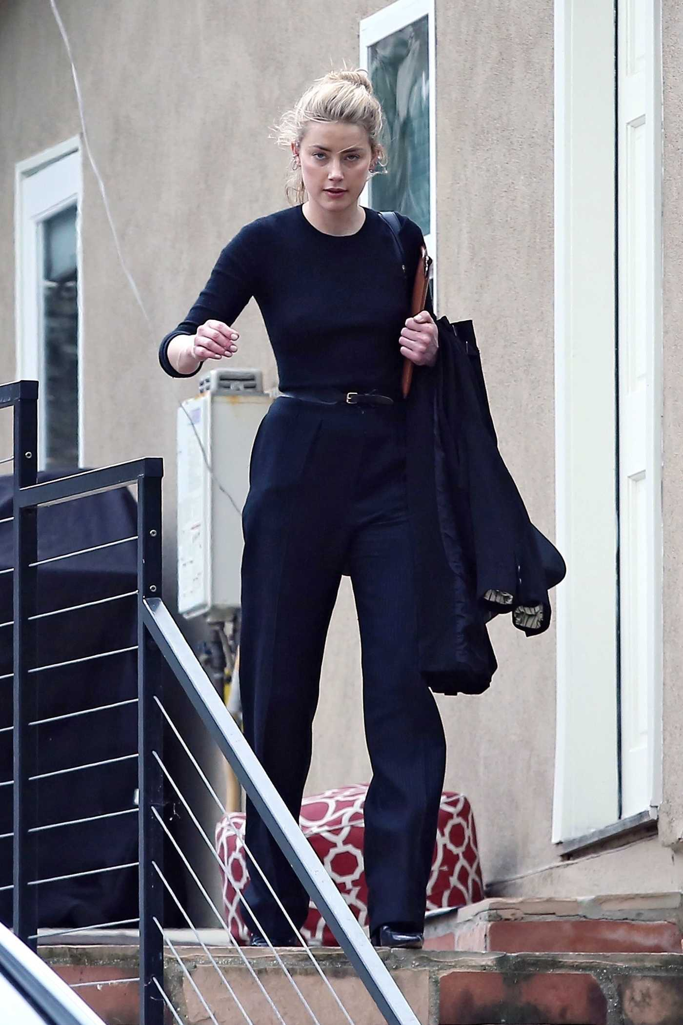 Amber Heard in a Black Sweatshirt Attends a Business Meeting in LA 03/21/2019