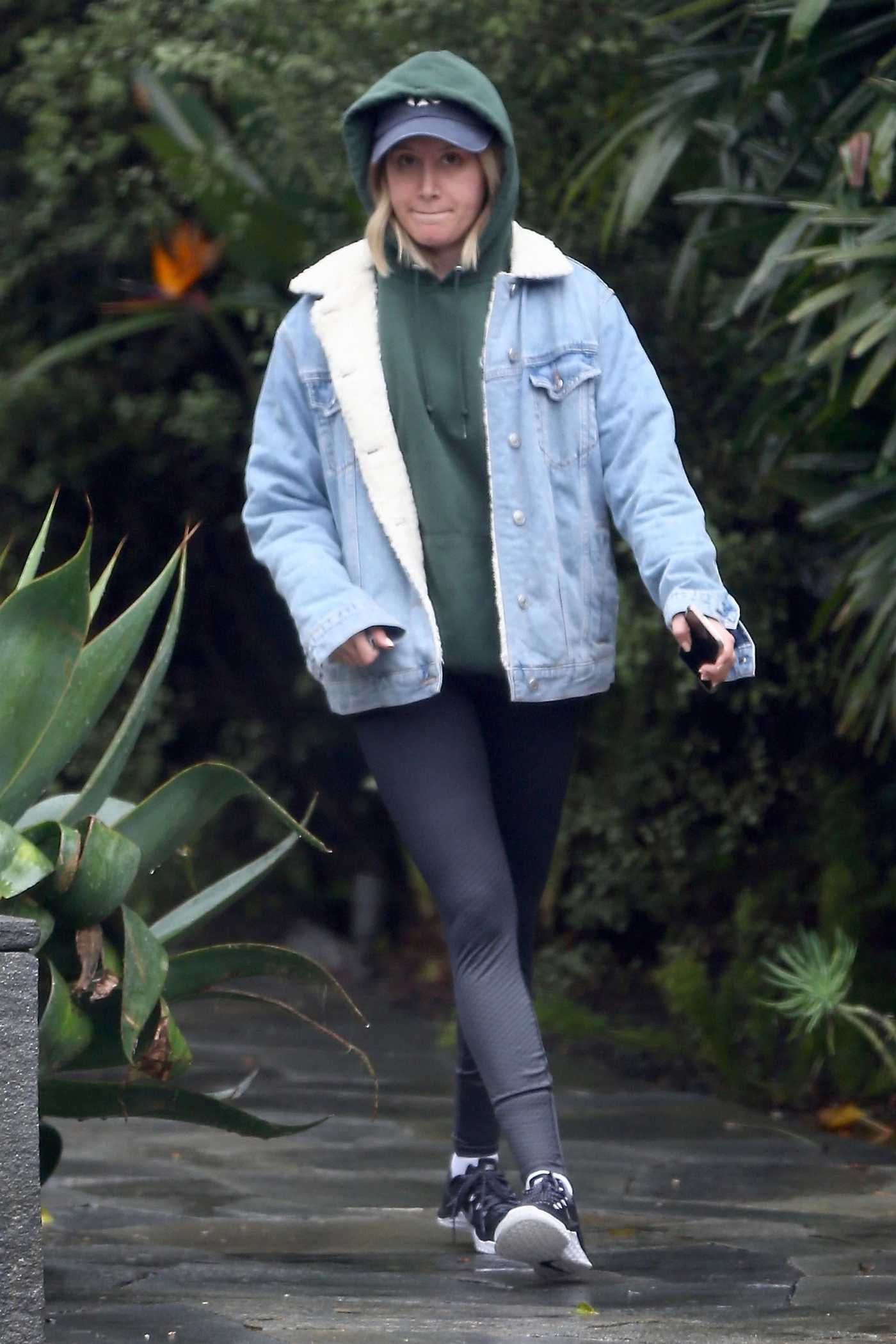 Ashley Tisdale in a Green Hoody Was Seen on a Rainy Day in West Hollywood 03/06/2019