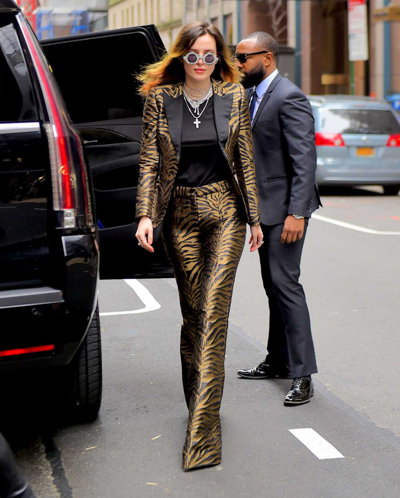 Bella Thorne in a Gold Suit Was Seen Out in NYC 03/25/2019