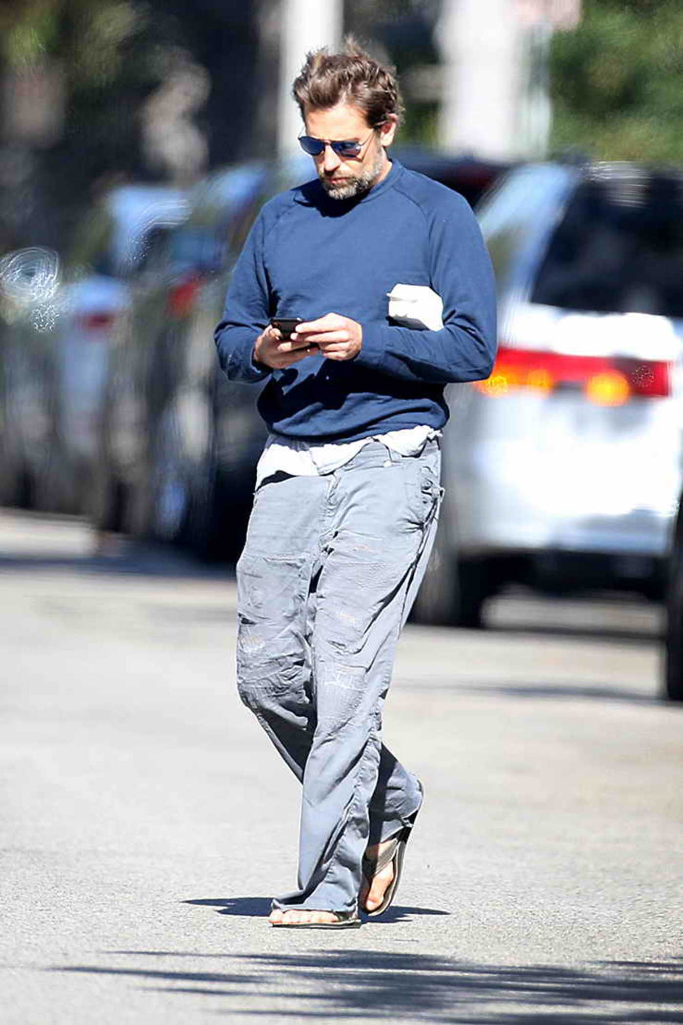 Bradley Cooper in a Blue Long Sleeves T-Shirt Was Seen Out in Los Angeles 02/25/2019