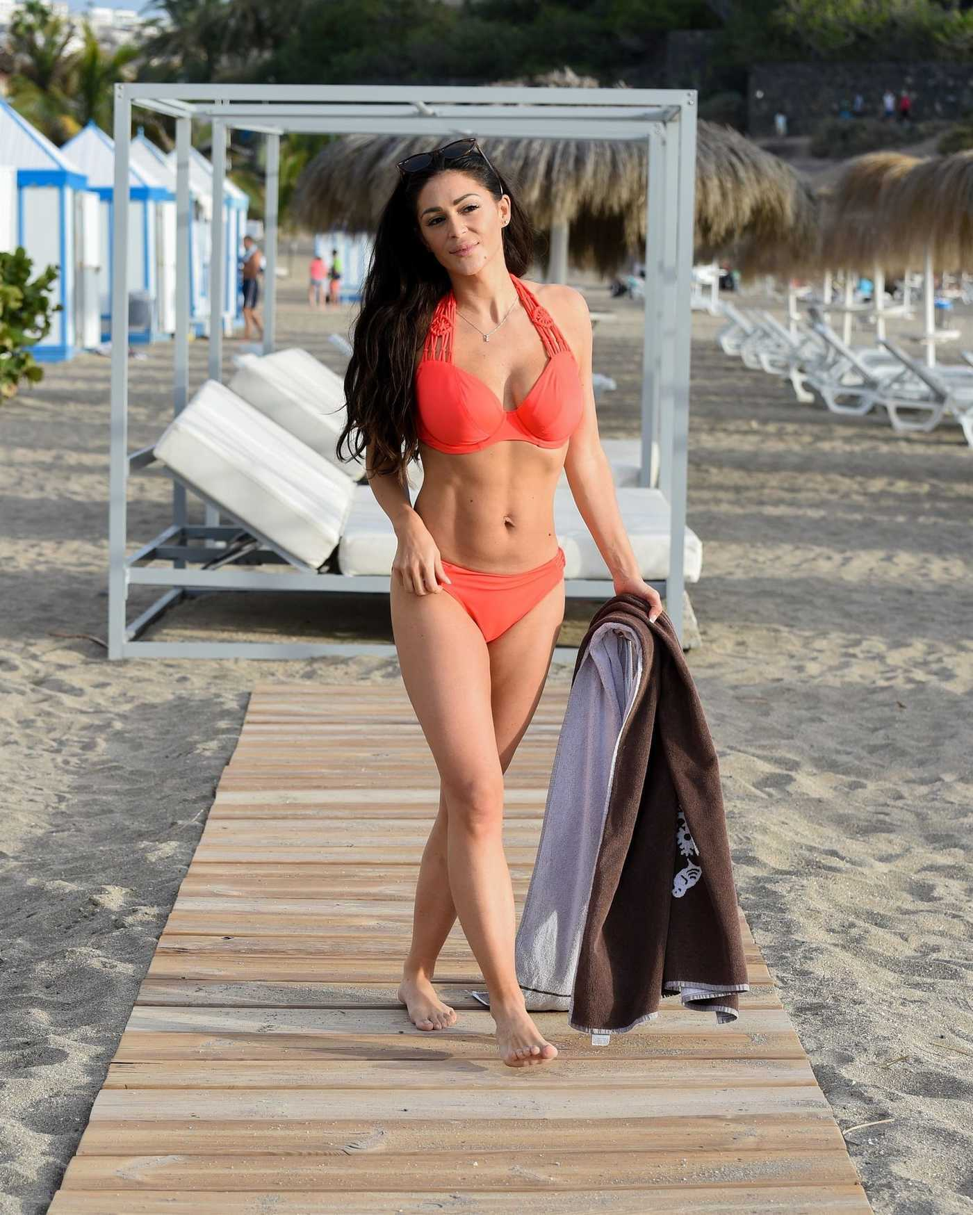 Casey Batchelor in a Red Bikini on the Beach in Tenerife 03/24/2019