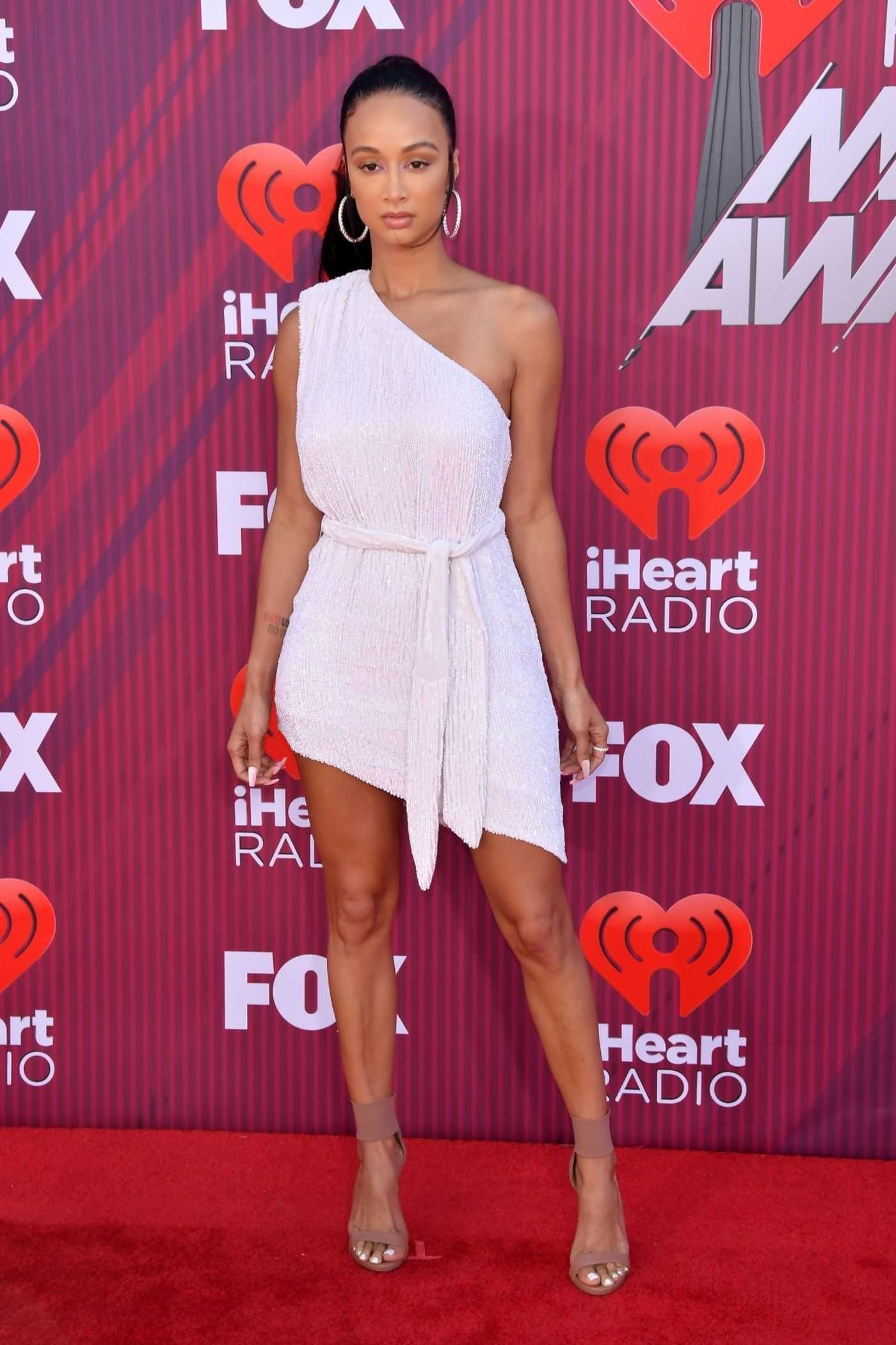 Draya Michele Attends 2019 iHeartRadio Music Awards at Microsoft Theater in LA 03/14/2019