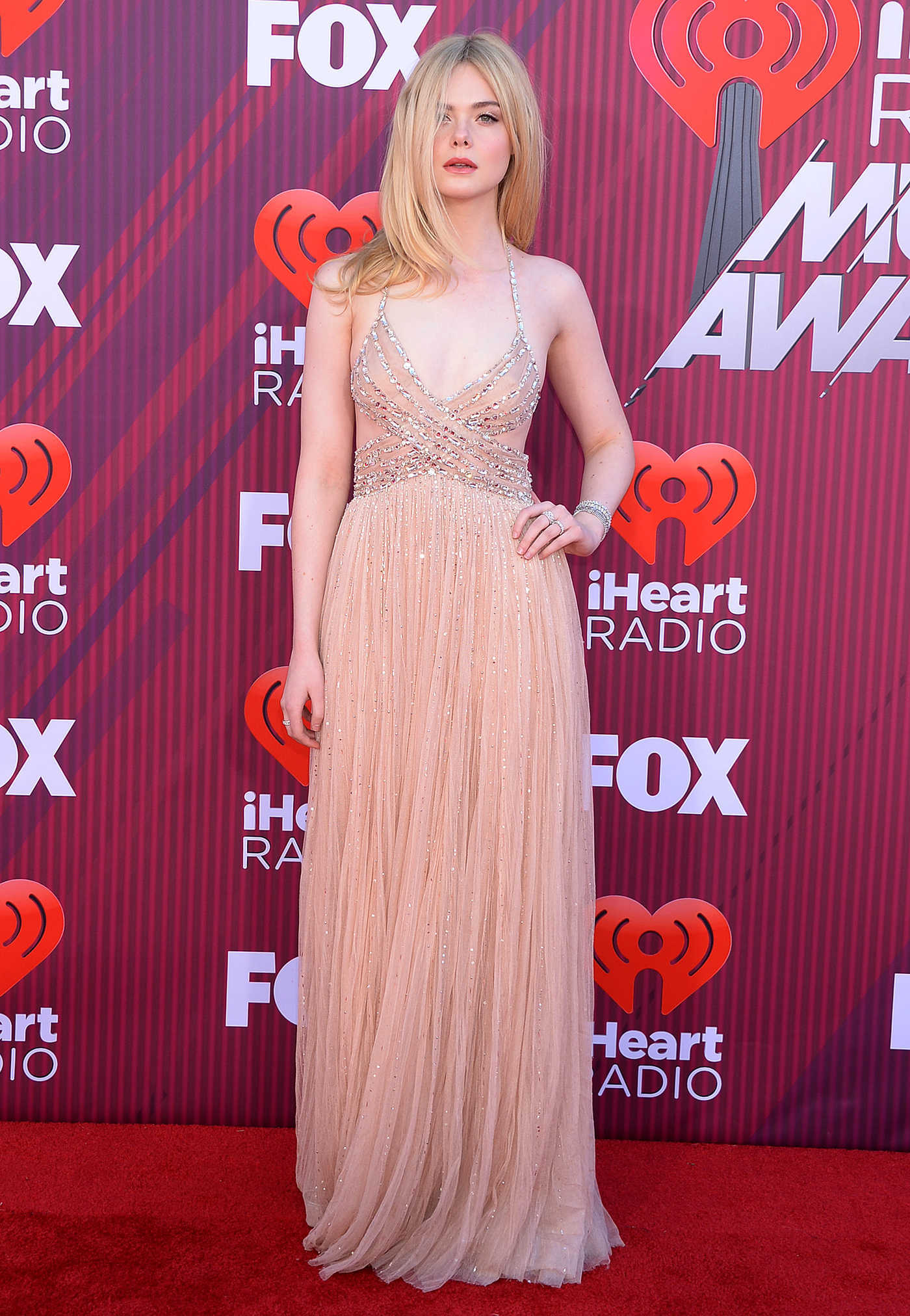Elle Fanning Attends 2019 iHeartRadio Music Awards at Microsoft Theater in LA 03/14/2019