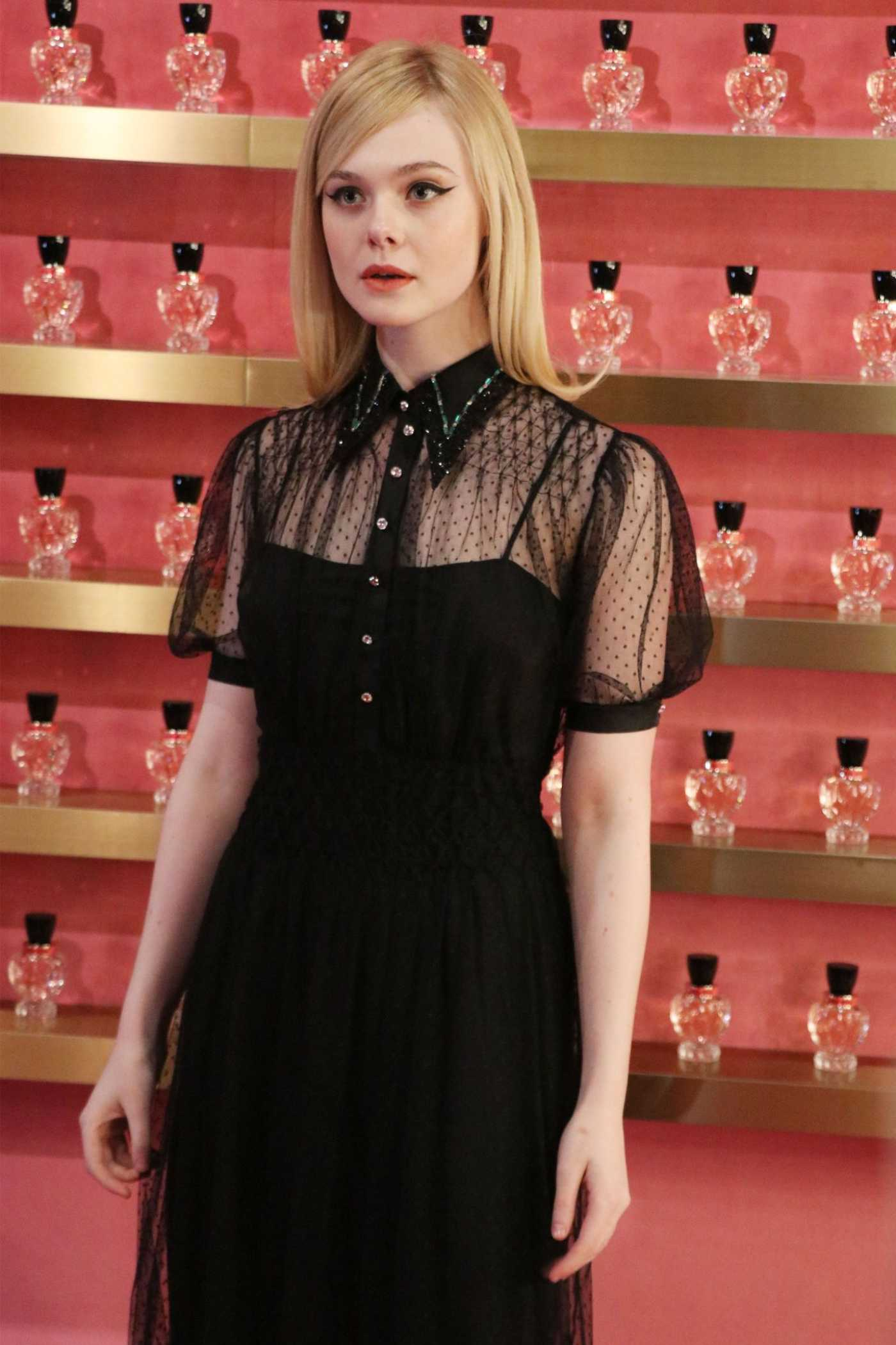 Elle Fanning Attends the Miu Miu Event in Shanghai 03/26/2019