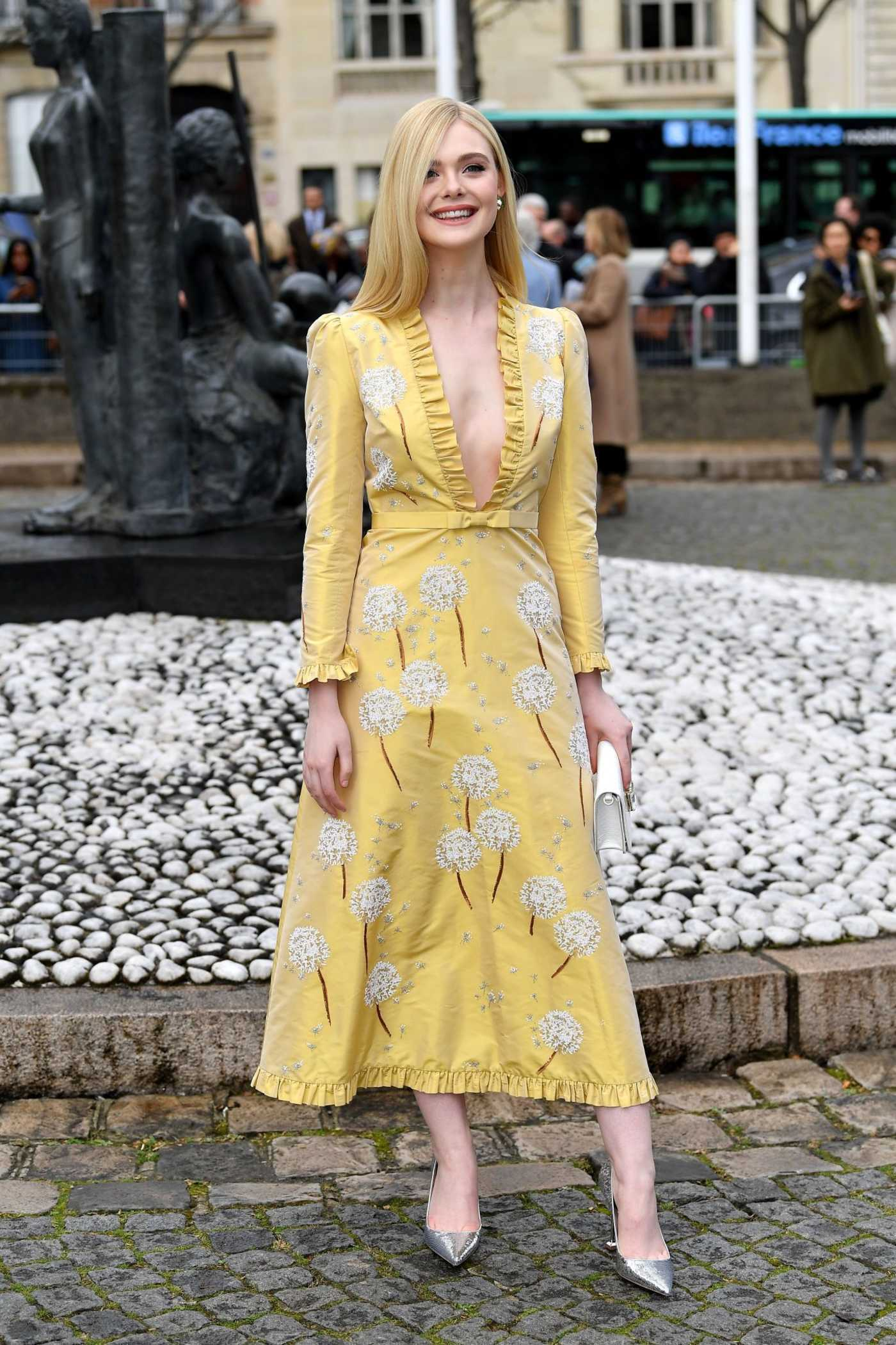 Elle Fanning in a Yellow Floral Dress Leaves the Miu Miu Fashion Show During PFW in Paris 03/05/2019