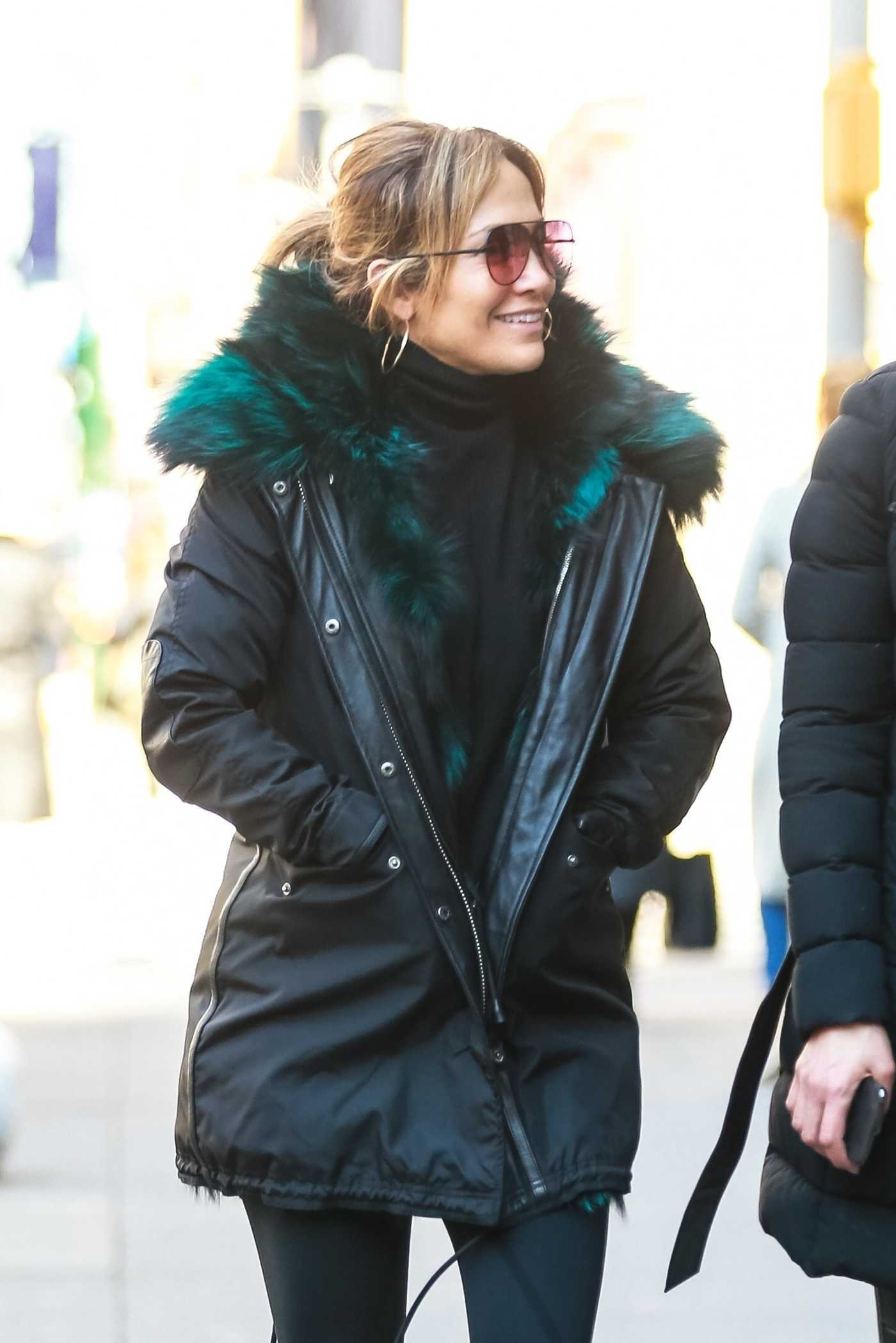 Jennifer Lopez in a Black Parka Was Seen Out with Her Sister Lynda in NYC 03/18/2019