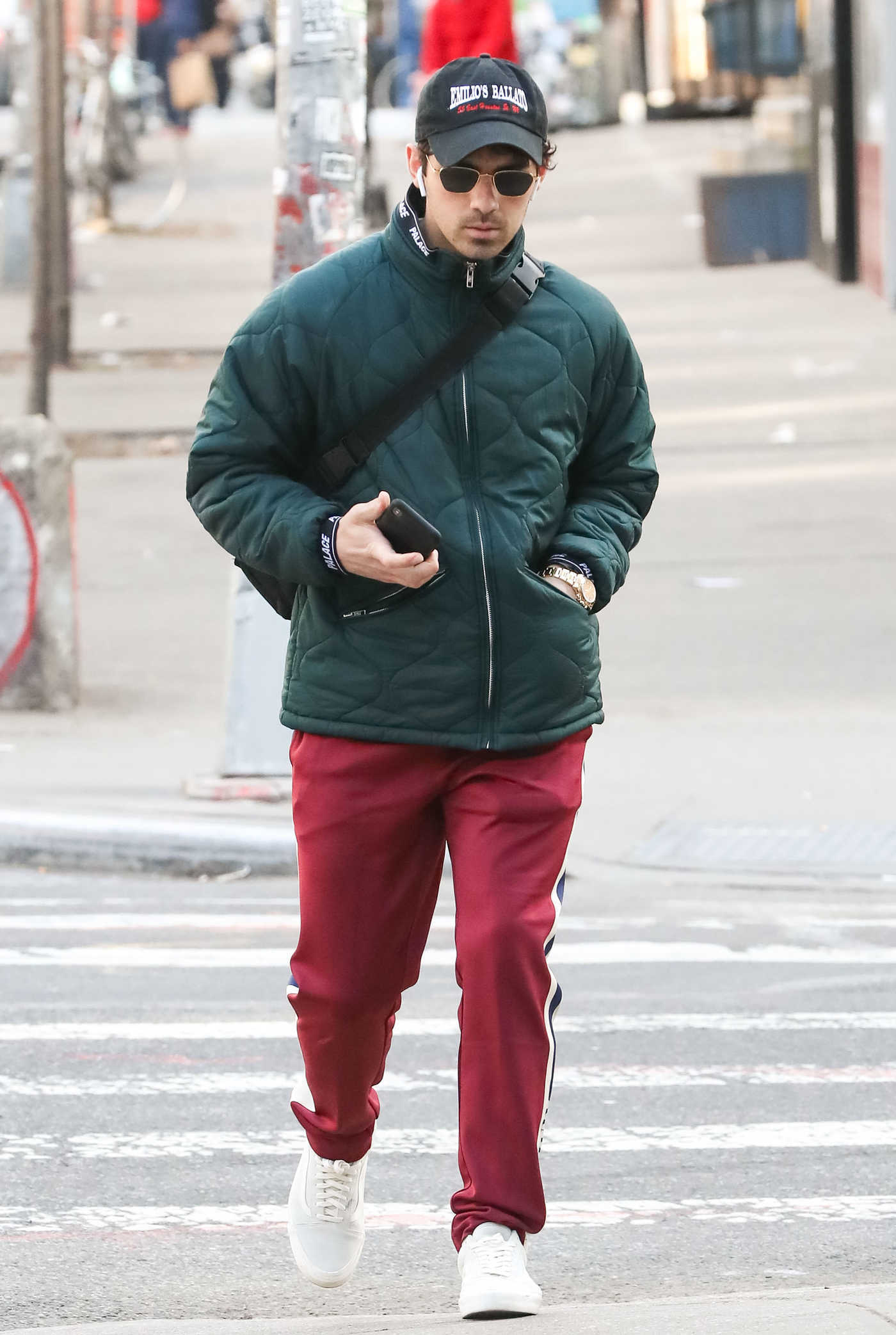 Joe Jonas in a Red Track Pants Was Seen Out in New York 03/20/2019