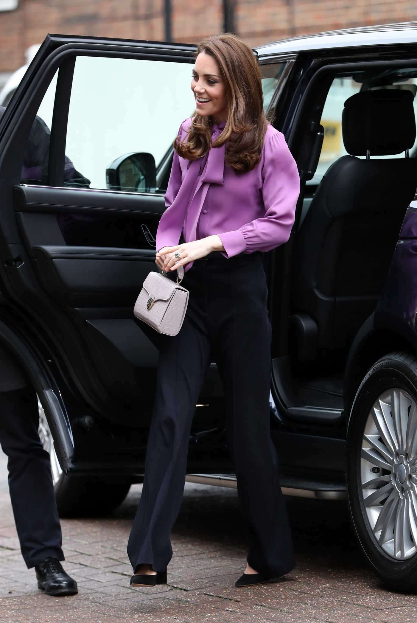 Kate Middleton in a Purple Blouse Visits Henry Fawcett Children's Centre in London 03/12/2019